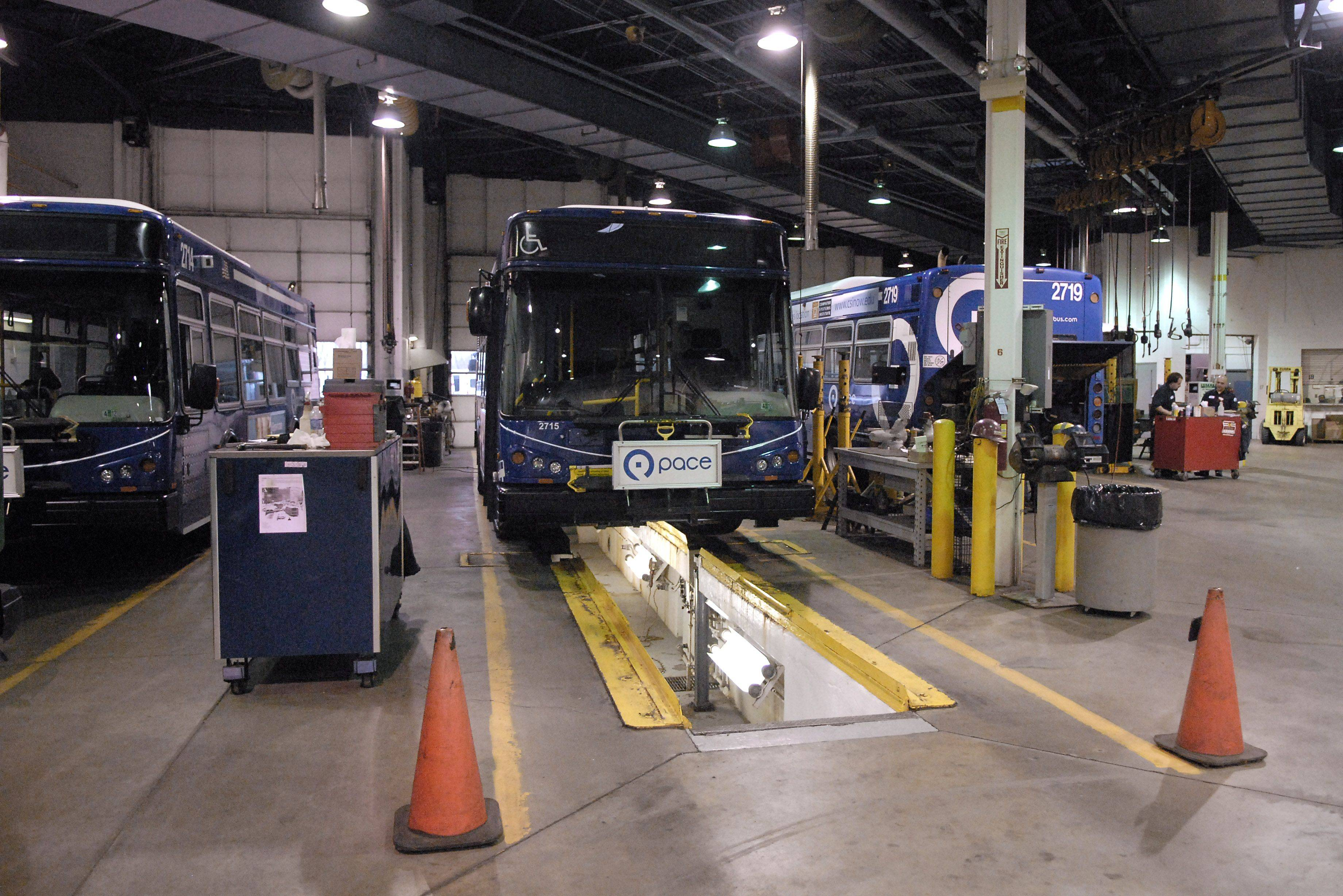 The Pace bus garage in Elgin has five service bays, with one of them having lower access to change fluids. The garage has six mechanics who work on three staggered shifts throughout the day.