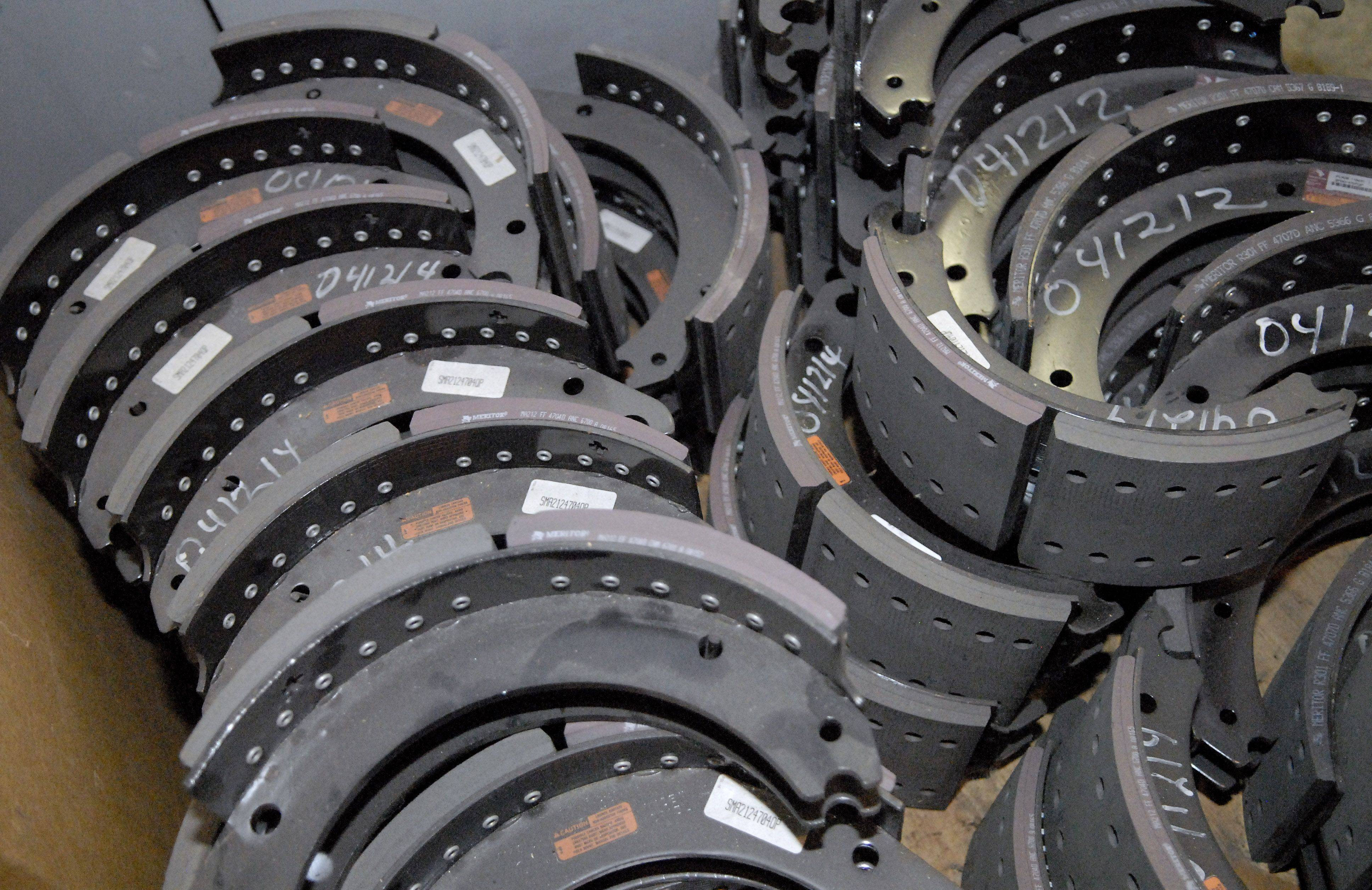 Brake shoes are neatly stacked ready to be used in the stock room of the Elgin Pace Bus garage.