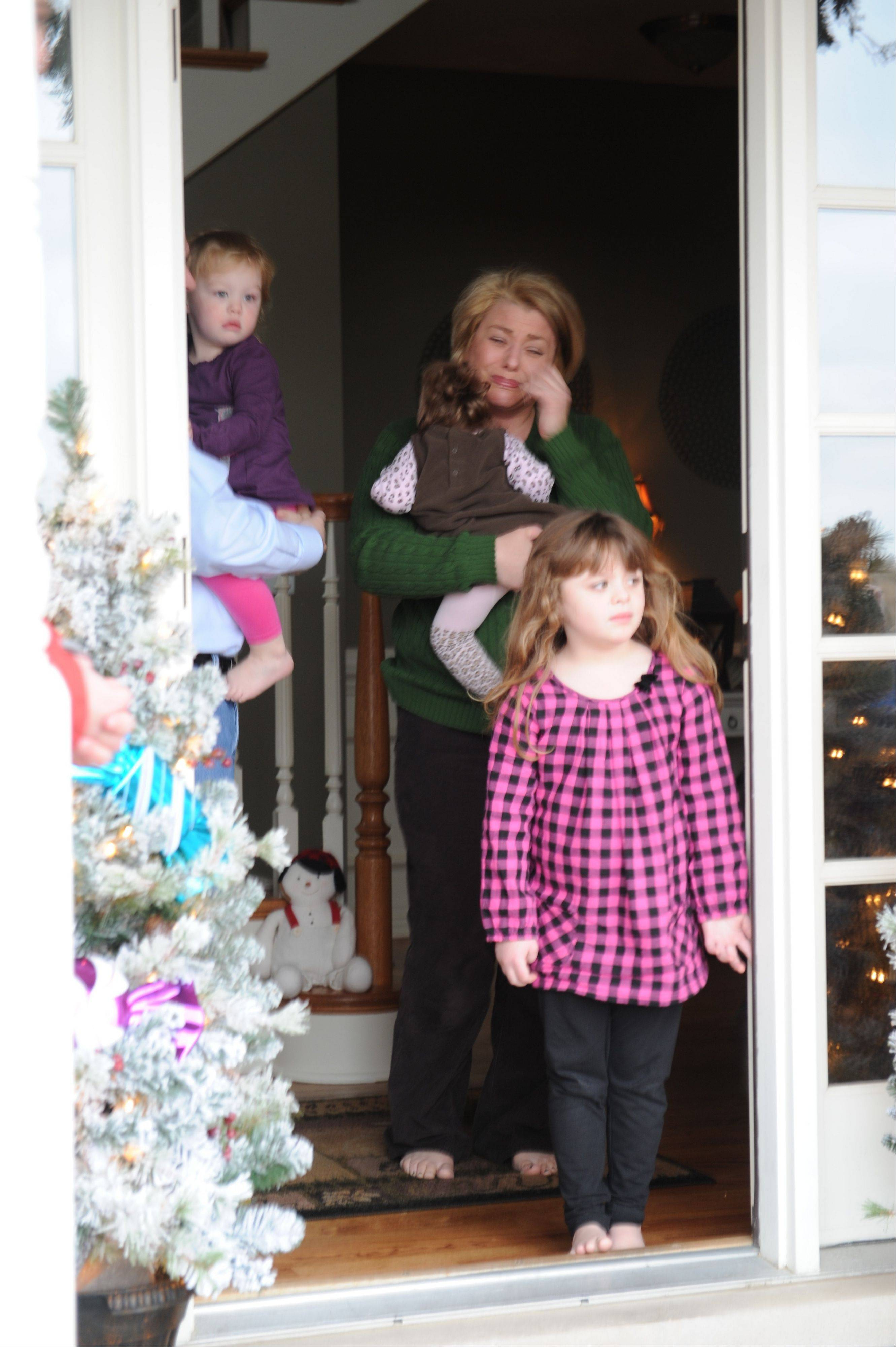 Luellen Seals tears up as she opens her door Friday afternoon to find about 60 members of her local church with a surprise gift for her 2-year-old daughter, Meagan.