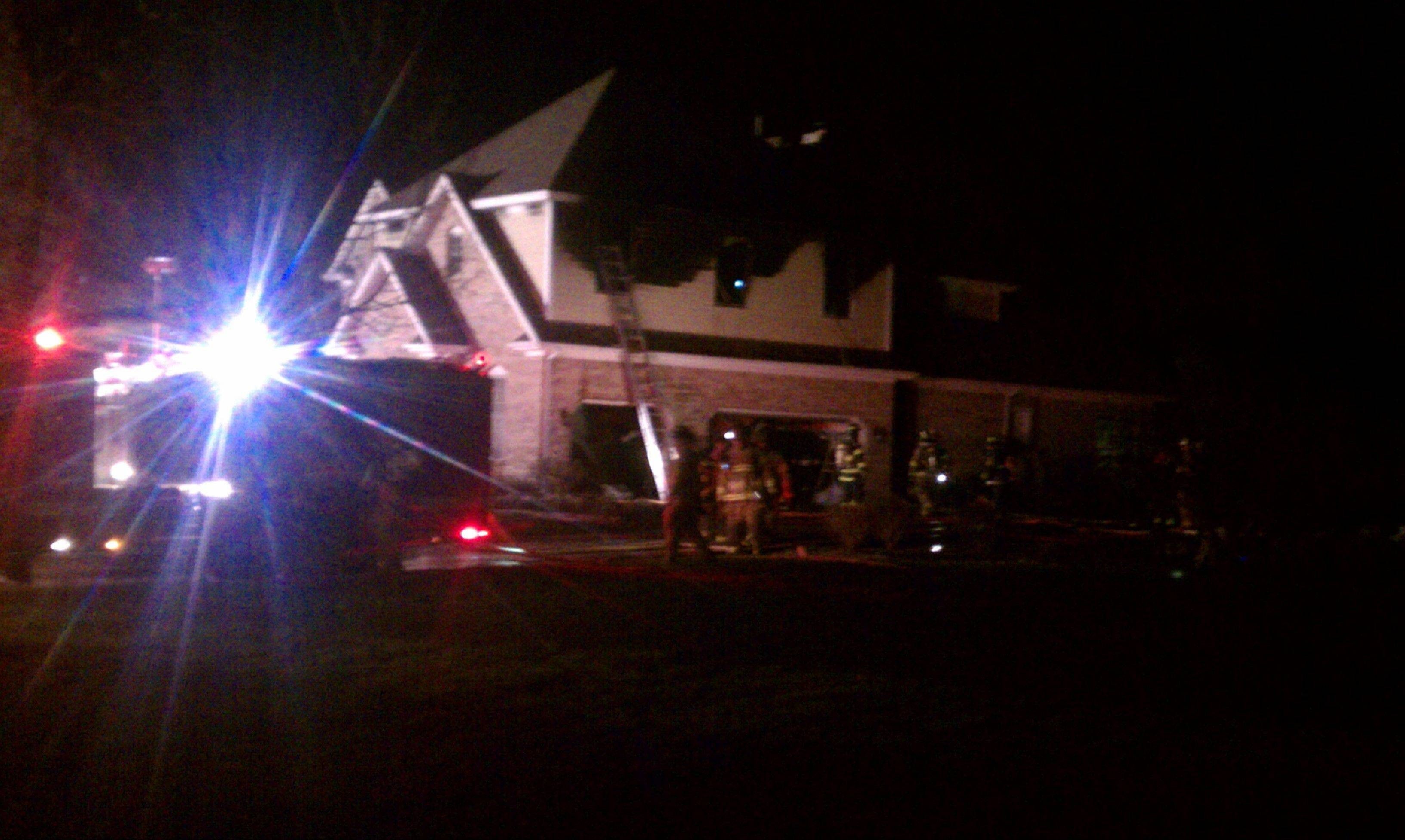 Fire crews work to extinguish a house fire in a subdivision near Elburn Friday night.
