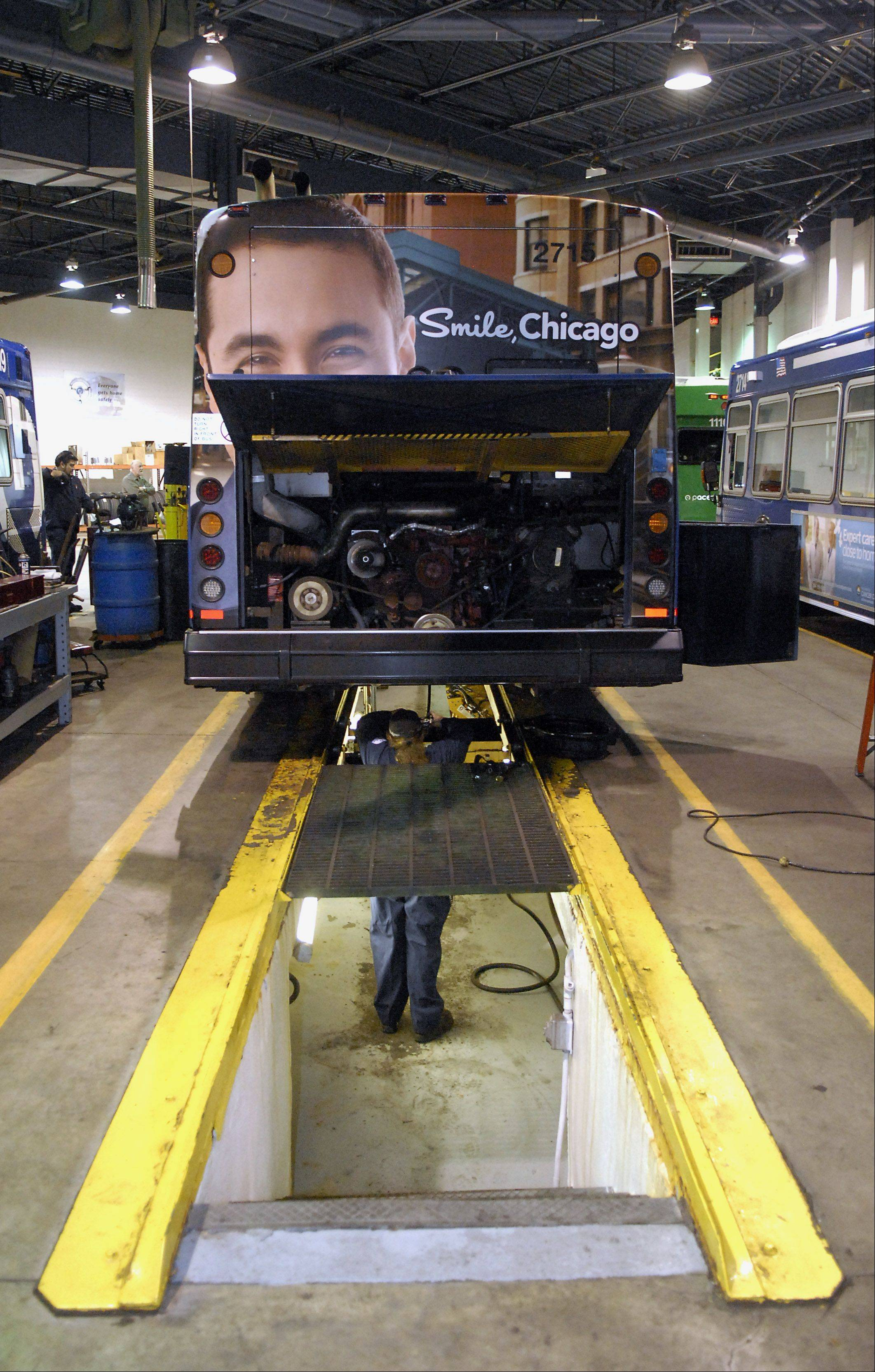 Mechanic Erik Hanning performs a work order on a bus.