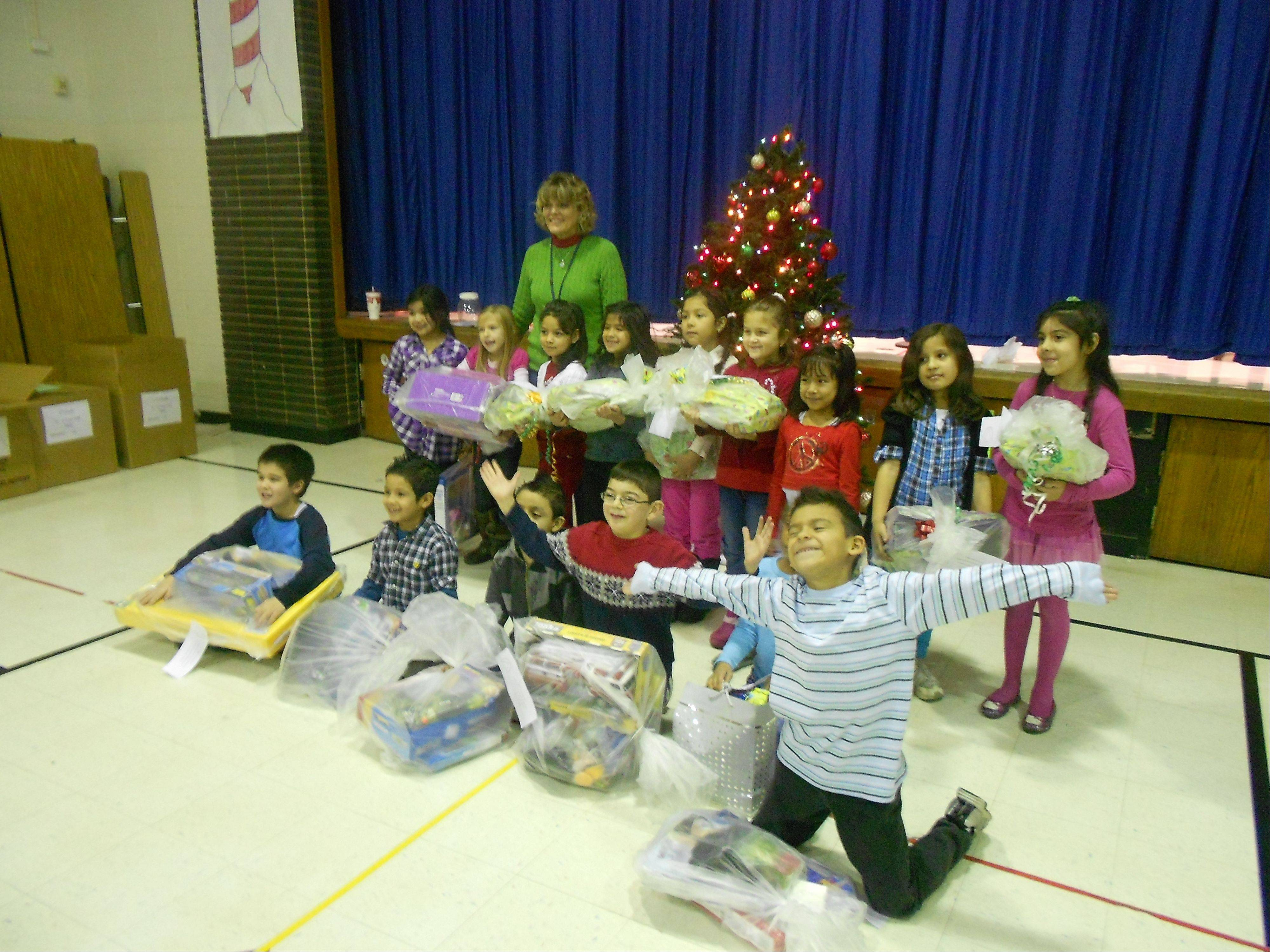 All 415 students at Lake Park Elementary School in Addison received gifts this week from donations through the Humanitarian Service Project. The organization chose Lake Park because of its large number of low-income families.