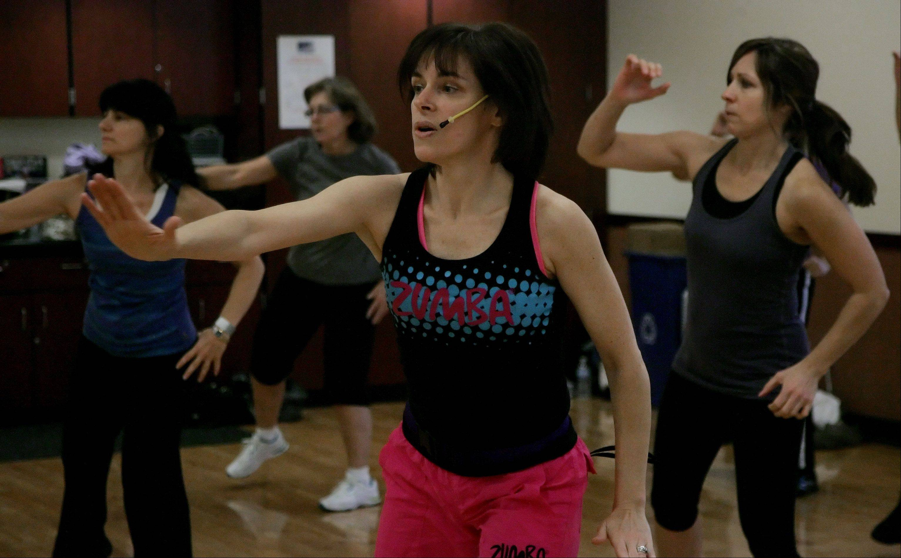 Instructor Carol Specht leads a Zumba class at the Hunt Club Park Fitness Center in Gurnee. The Gurnee Park District offered discounts for their fitness classes online through Groupon's daily deals.
