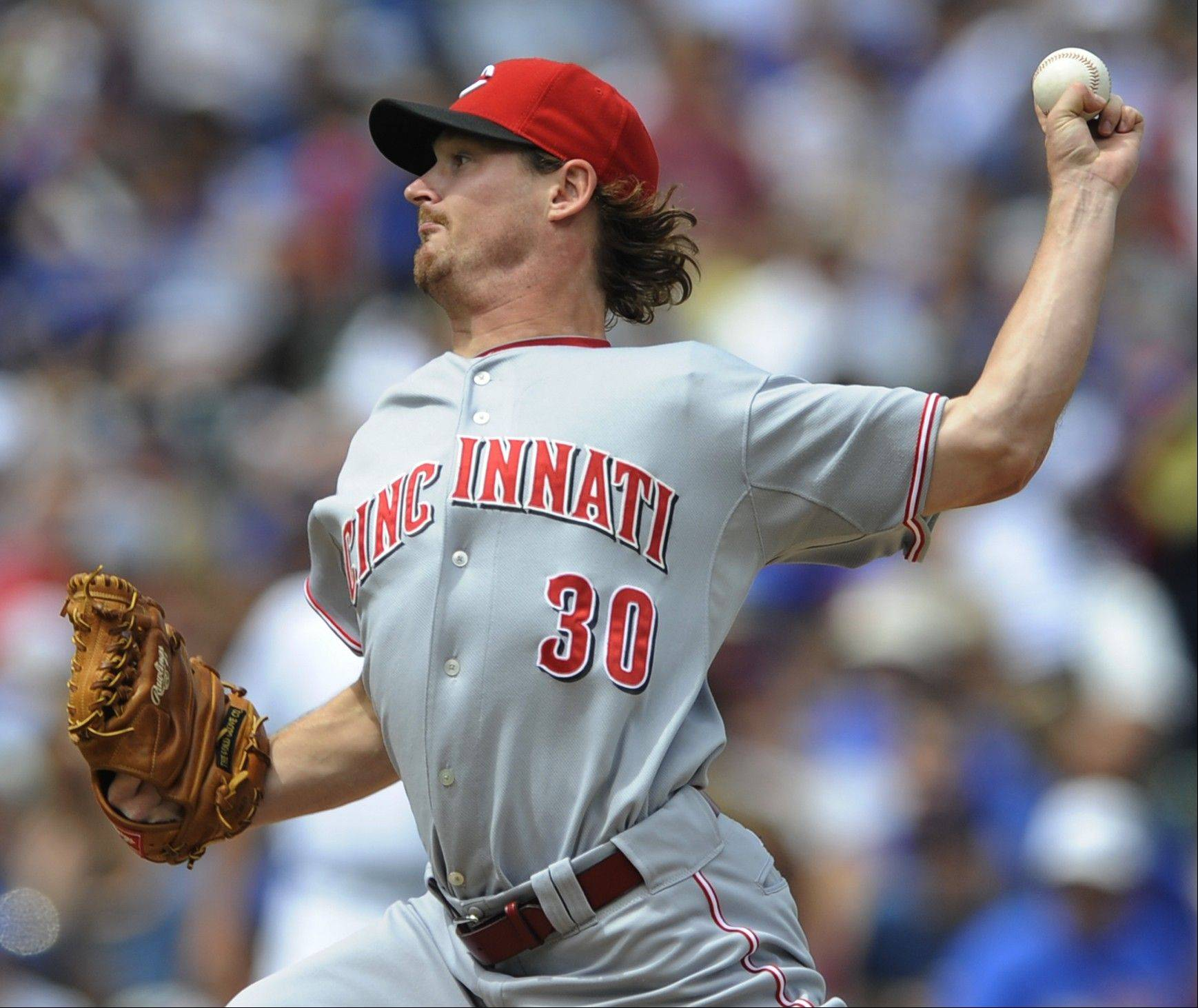 Reds starter Travis Wood, who made his major-league debut against the Cubs in 2010, was acquired by the Cubs on Friday along with two prospects in exchange for lefty reliever Sean Marshall. The Reds had no room in their rotation for Wood, but the rebuilding Cubs needed a lefty.