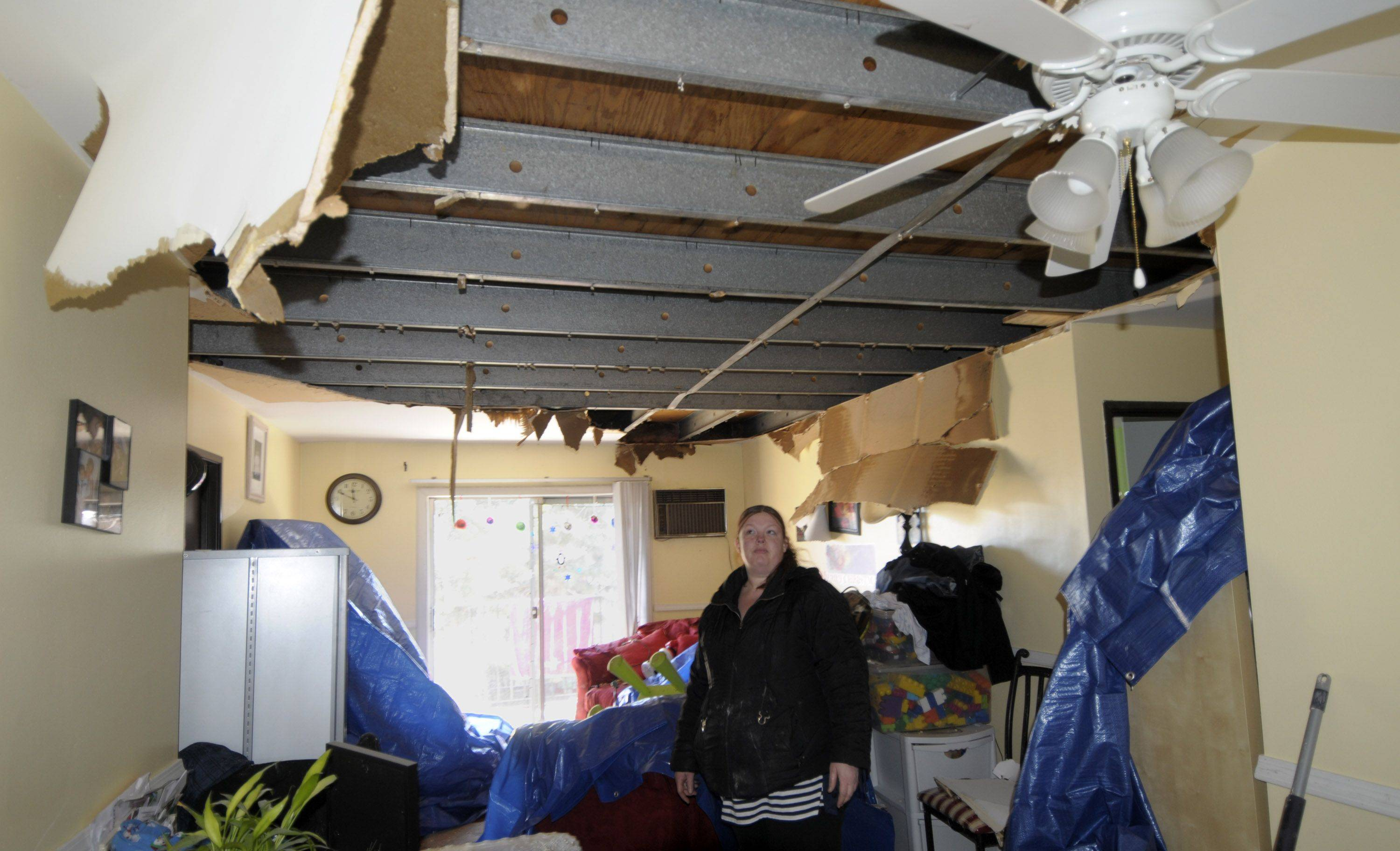 Lorena Marquez surveys the damage in her second-floor apartment.