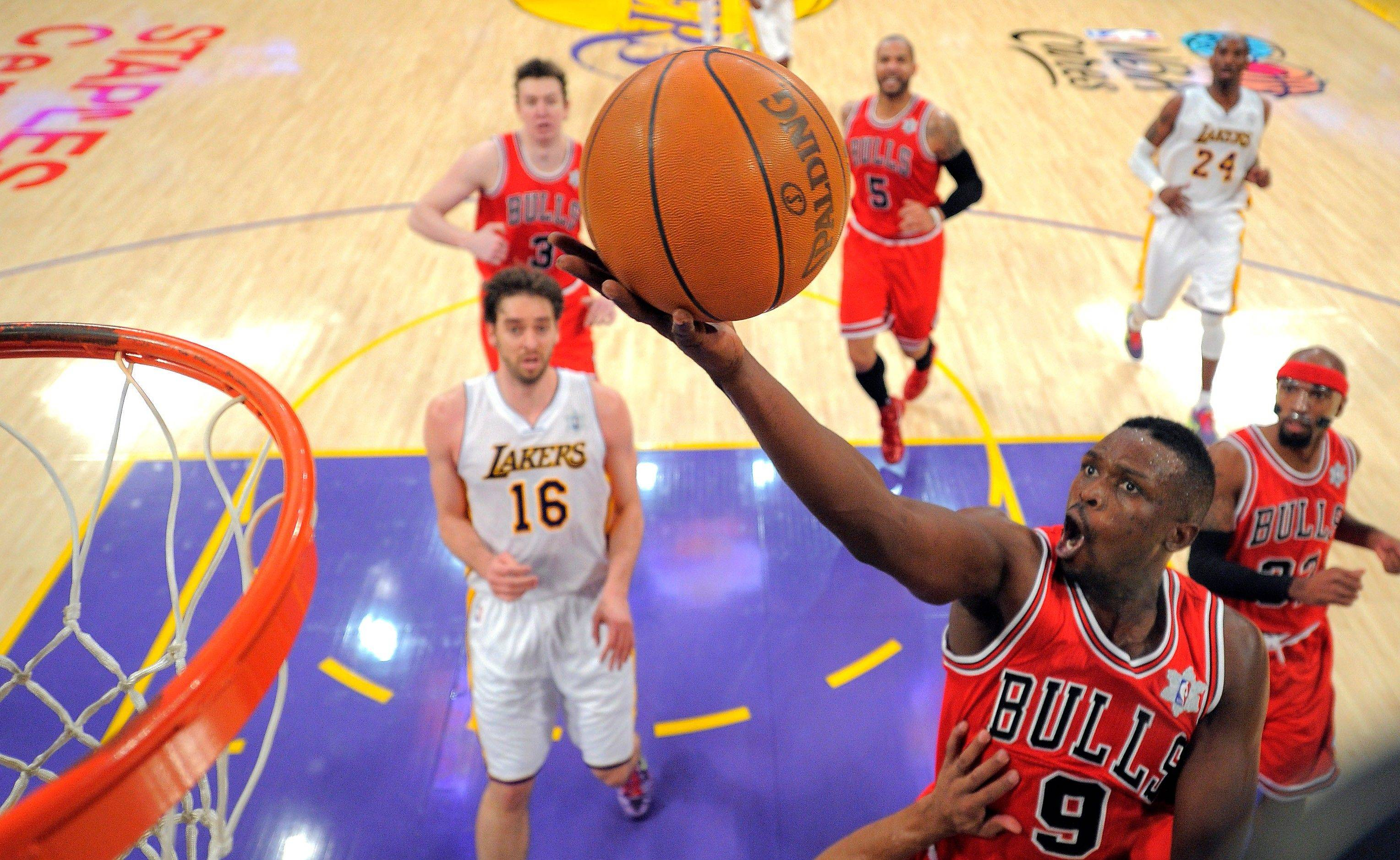 Bulls forward Luol Deng puts up a shot as Los Angeles Lakers forward Pau Gasol watches during the first half Sunday in Los Angeles.