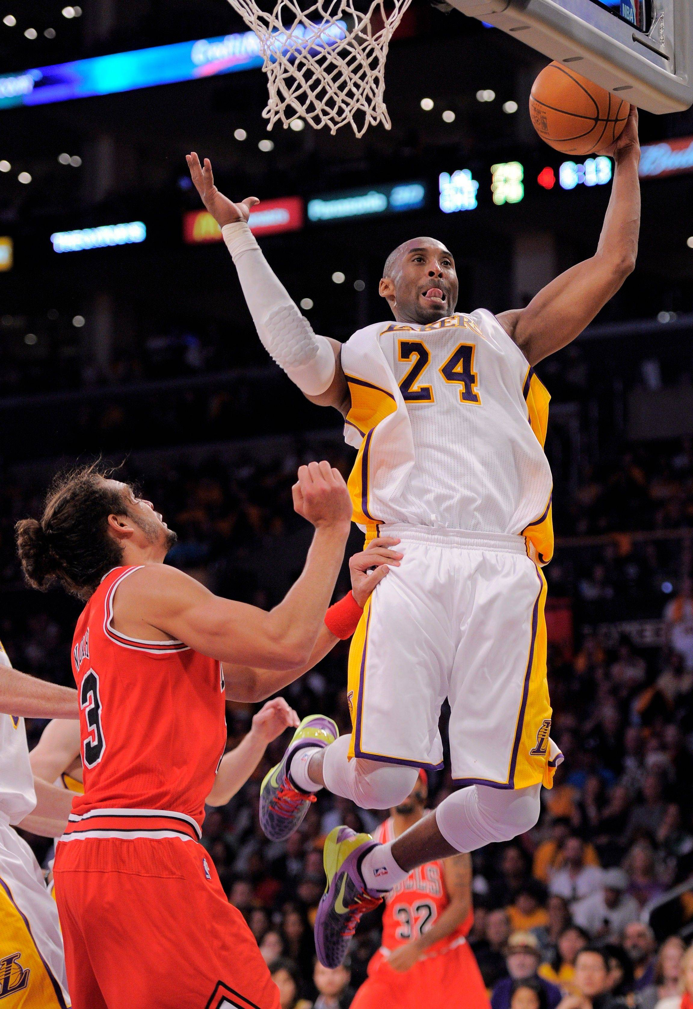 Los Angeles Lakers guard Kobe Bryant grabs a rebound as Bulls center Joakim Noah defends during the second half Sunday.