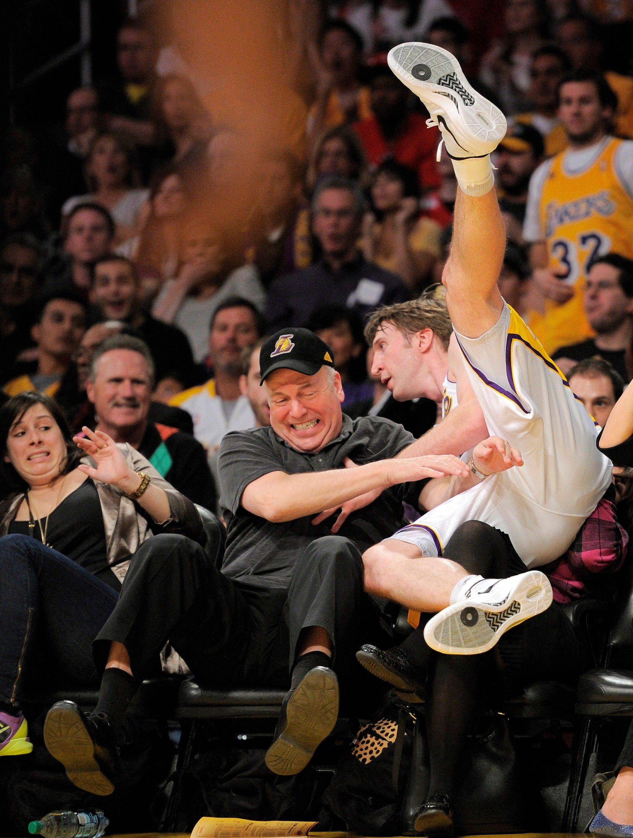Los Angeles Lakers forward Troy Murphy falls into the crowd as he goes after a loose ball Sunday against Chicago.