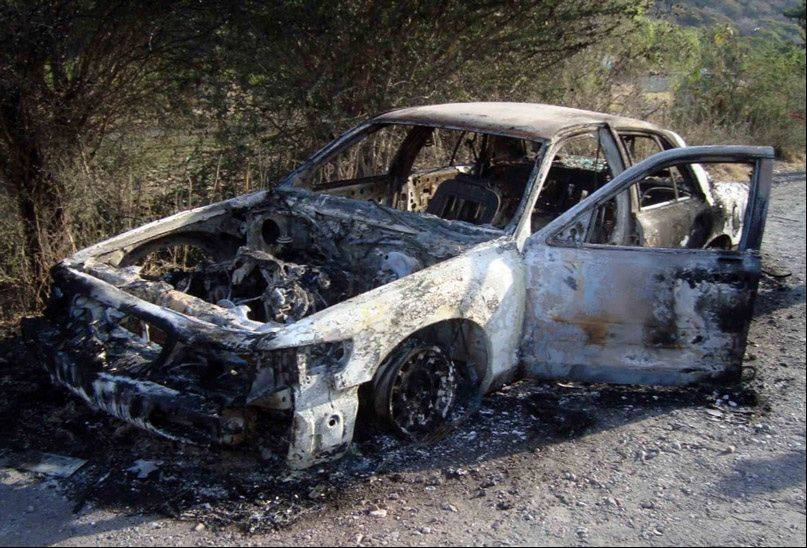 The bodies of Rolling Meadows High School senior Alexis Marron and two other men were found Saturday morning in the trunk of this burned-out car in Mexico.