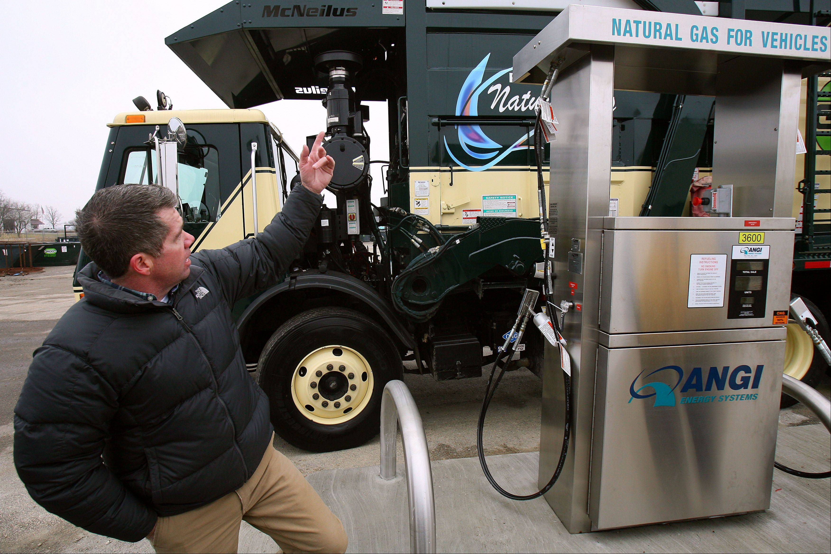 Brian Curry, director of fleet for Groot Industries, explains how new garbage trucks will use compressed natural gas as an alternative to diesel fuel. The company recently installed natural gas pumps at its Round Lake Park facility.