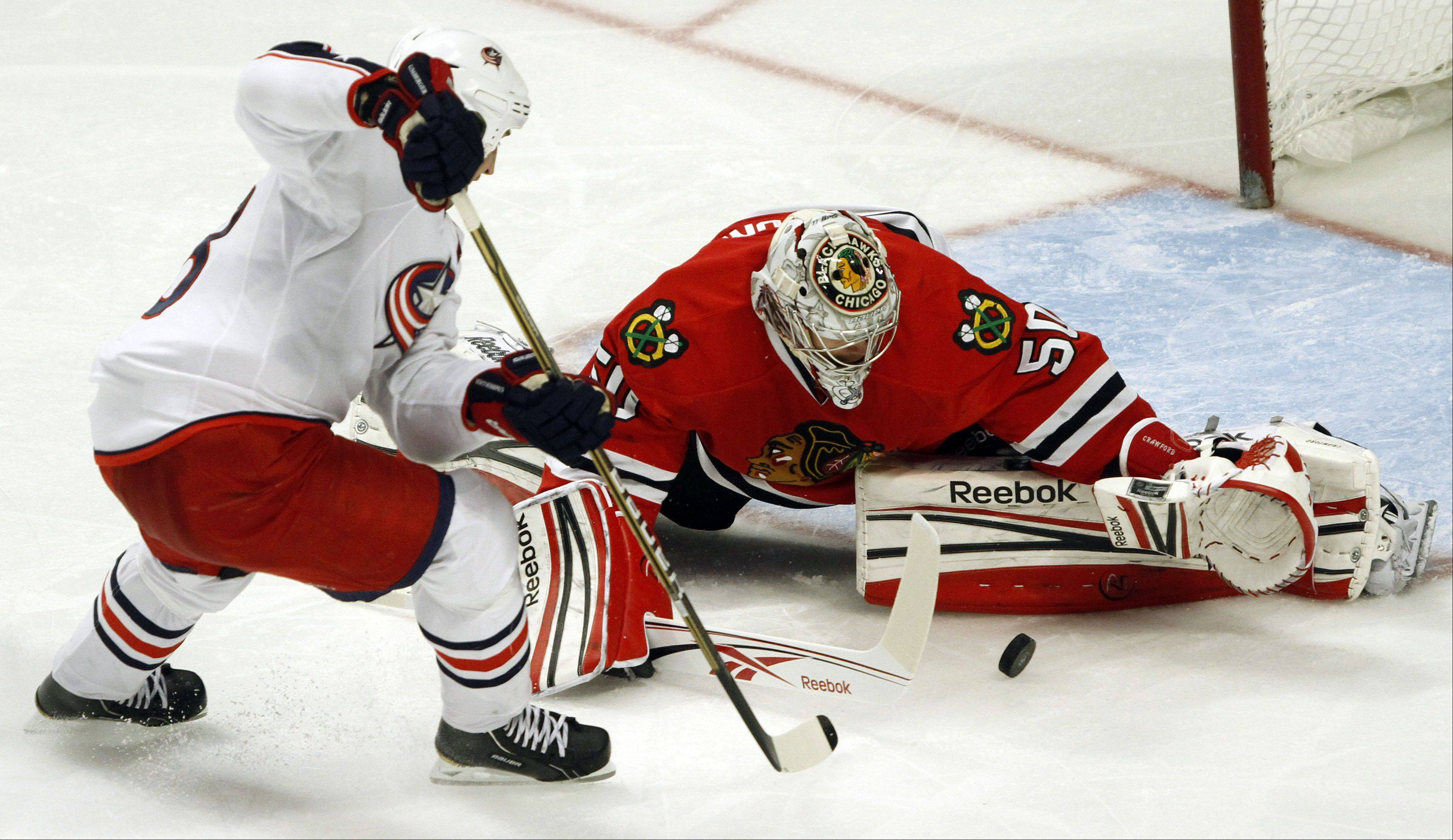 Blackhawks goalie Corey Crawford makes a save on the Blue Jackets' R.J. Umberger in the third period Monday night at the United Center in Chicago.
