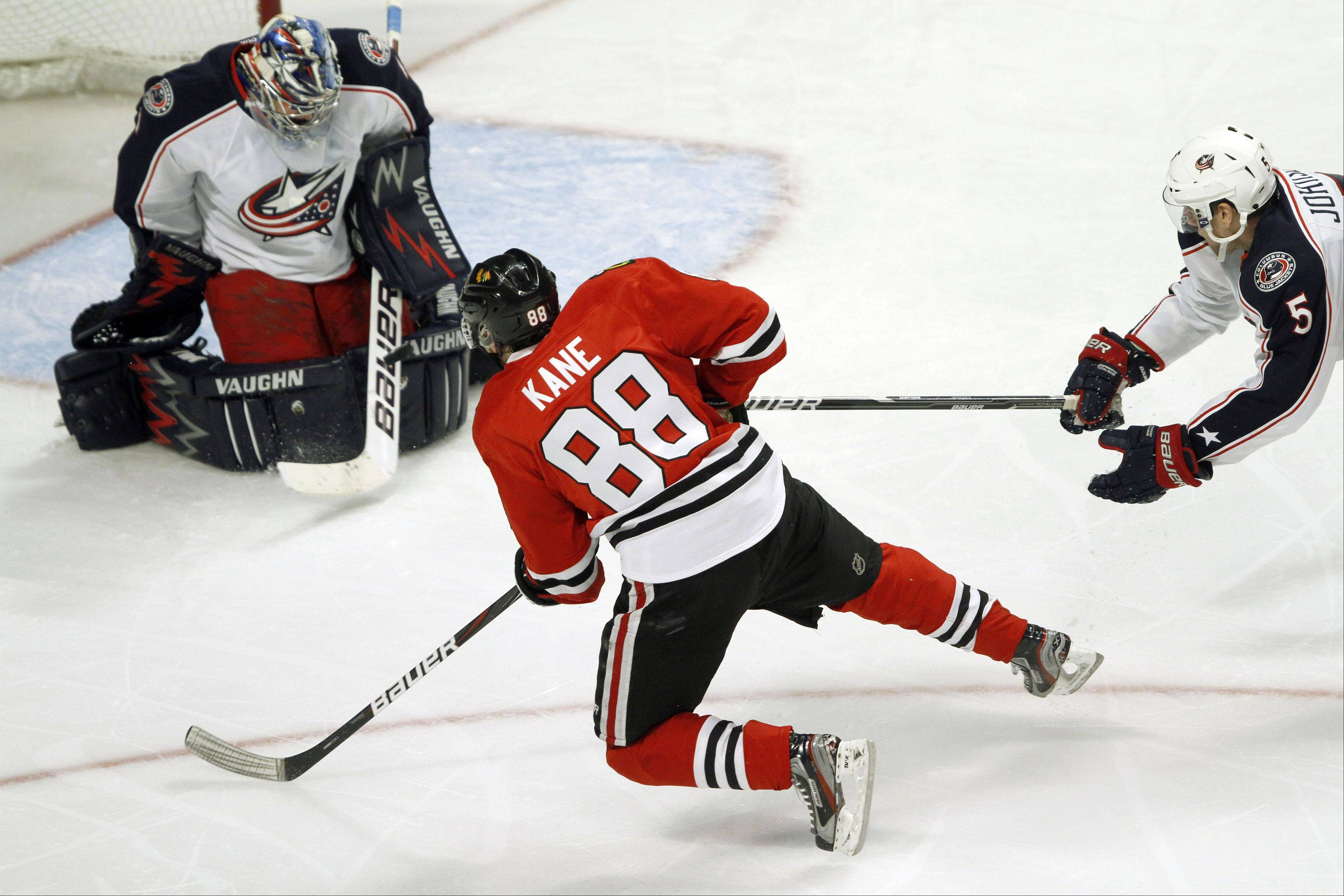 Blackhawks right wing Patrick Kane takes a diving shot on Columbus Blue Jackets goalie Steve Mason in the third period during their game Monday night at the United Center in Chicago.