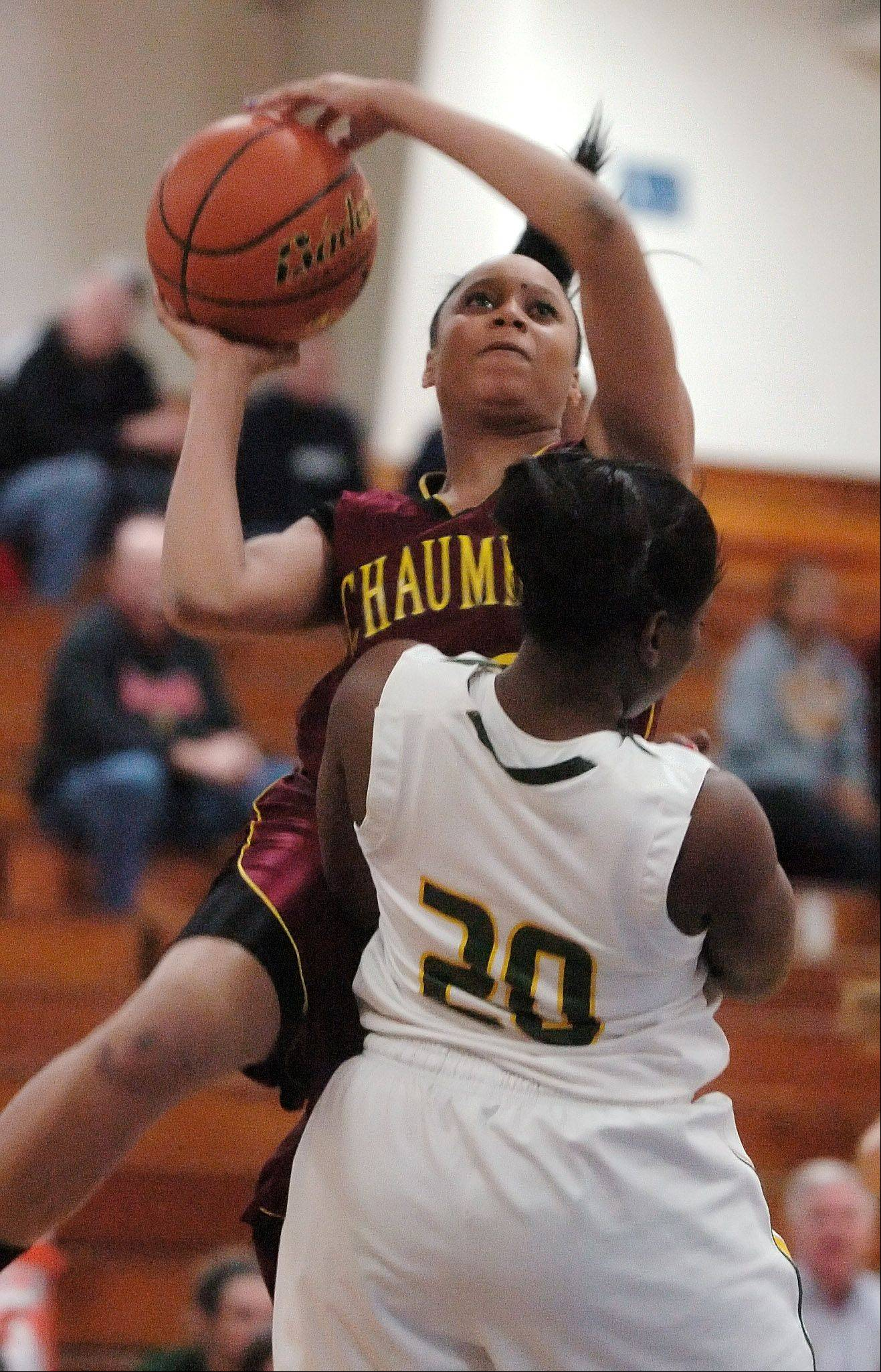 Jada Blackwell of Schaumburg heads up for a shot over Erica Jordan of Waubonsie Valley during the Bill Neibch Holiday girls basketball tournament Monday, December 26, 2011, at Wheaton North High School.