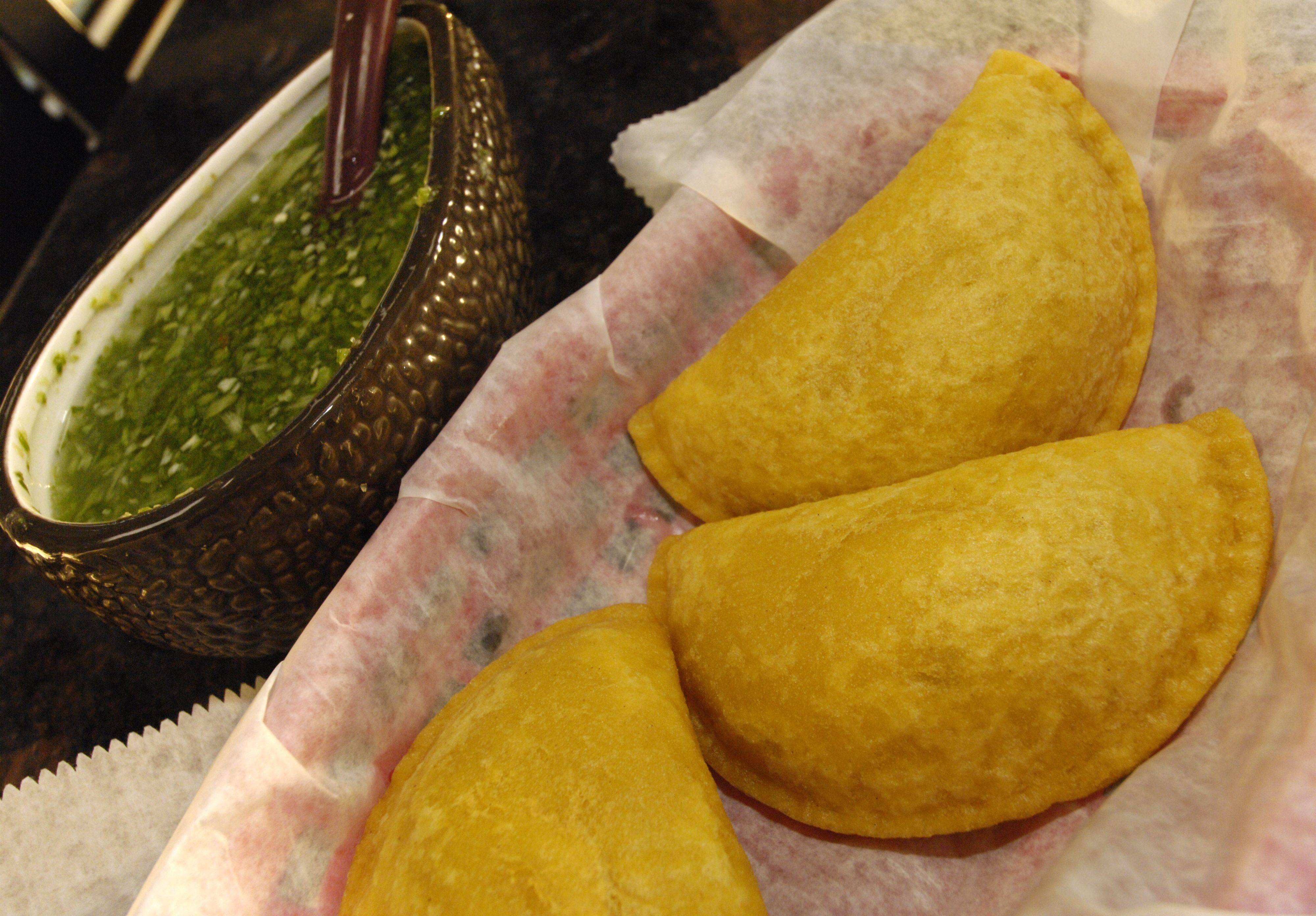 Empanadas de Pollo come with an addictive green aji at Colombian's Taste in Itasca.