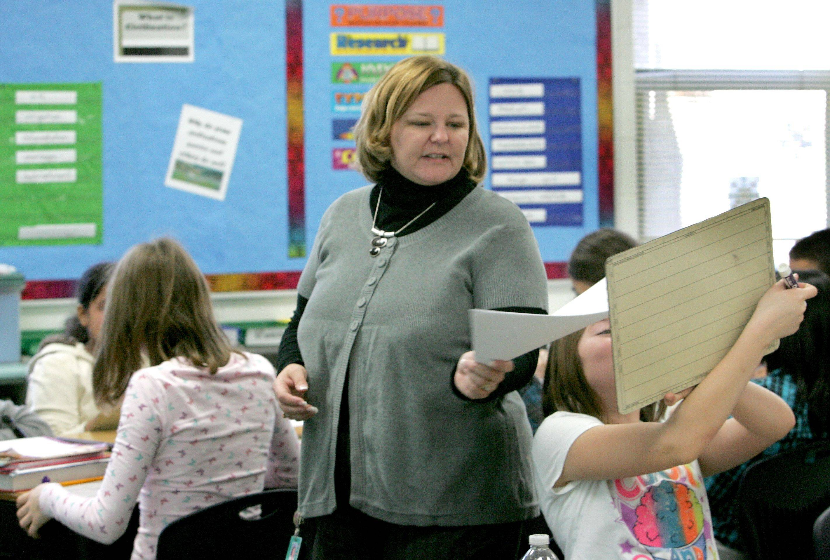 Karen Apostoli teaches math to sixth-grade students at Wegner Elementary School in West Chicago. Officials revamped the curriculum this year to emphasize more real-world applications.