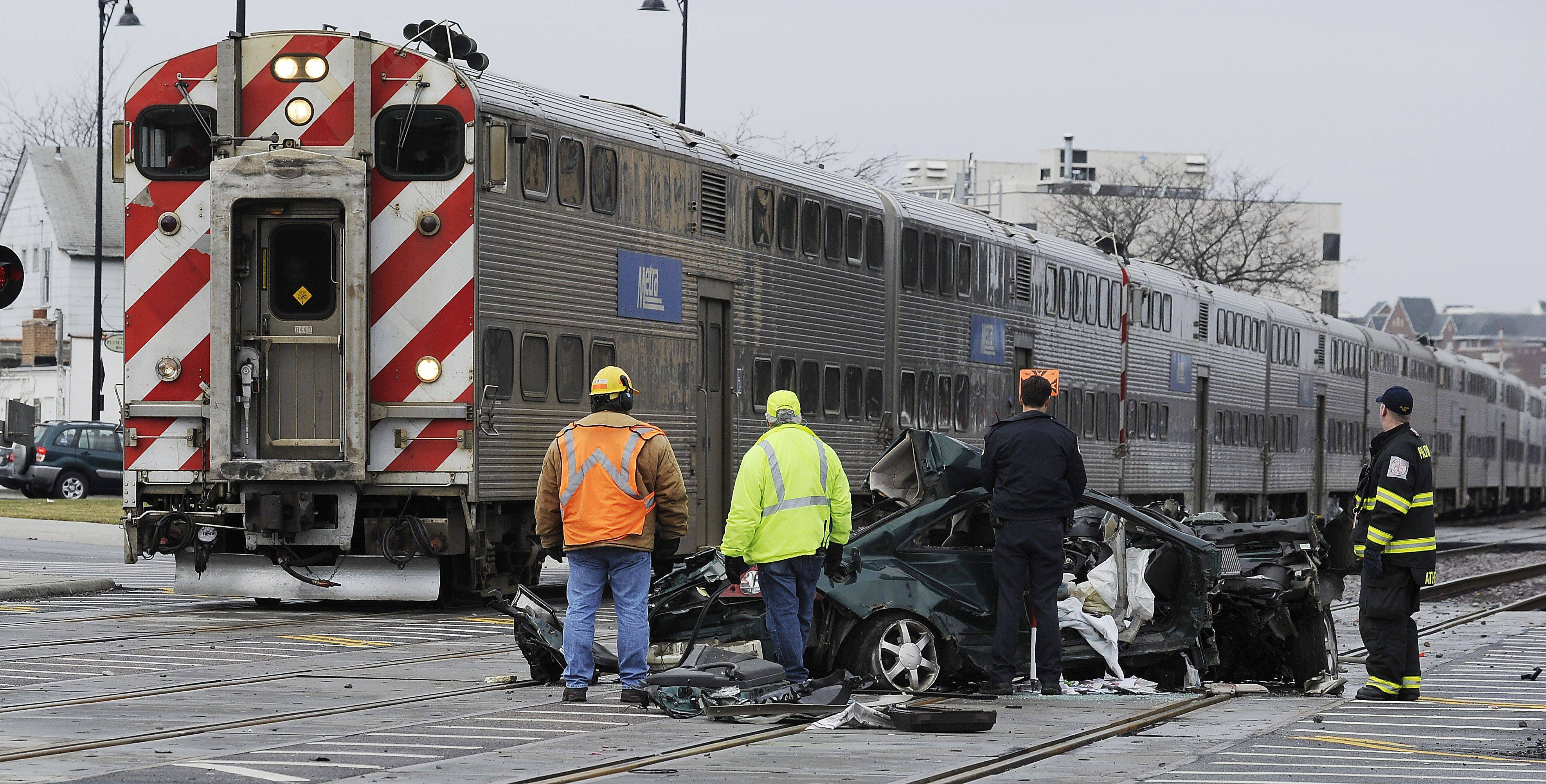 Palatine police and officials from Union Pacific Railroad investigate the car-train accident near Plum Grove and Palatine roads early Tuesday morning.
