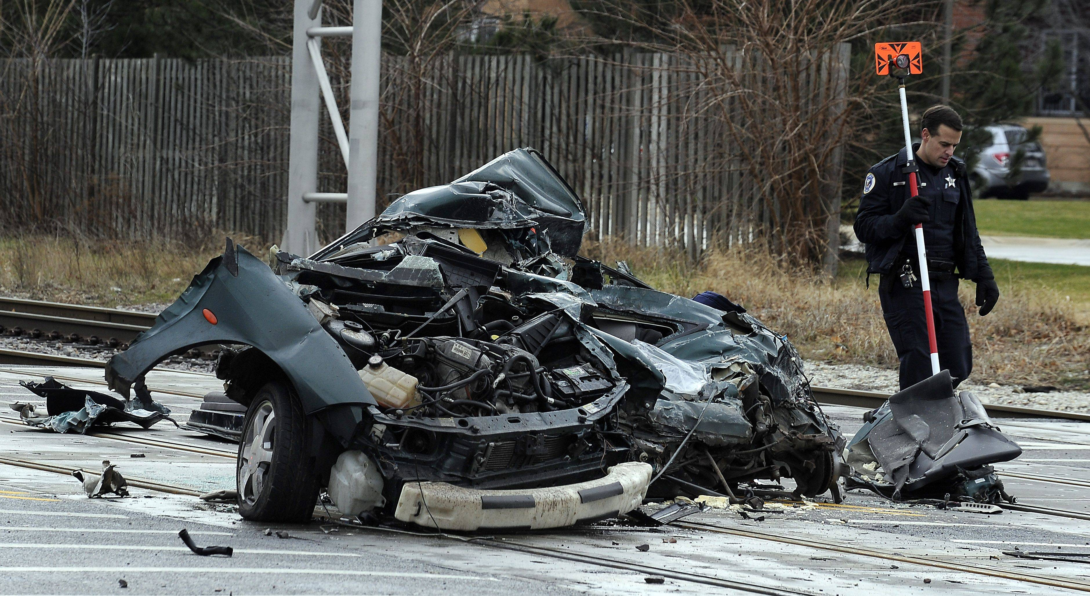 A 1999 Mercury was heavily damaged when it was struck by a train on the Union Pacific Northwest Line at Brockway Street in Palatine about 7:30 Tuesday morning. The impact killed the car's driver, 64-year-old Michael Levgard of Palatine.