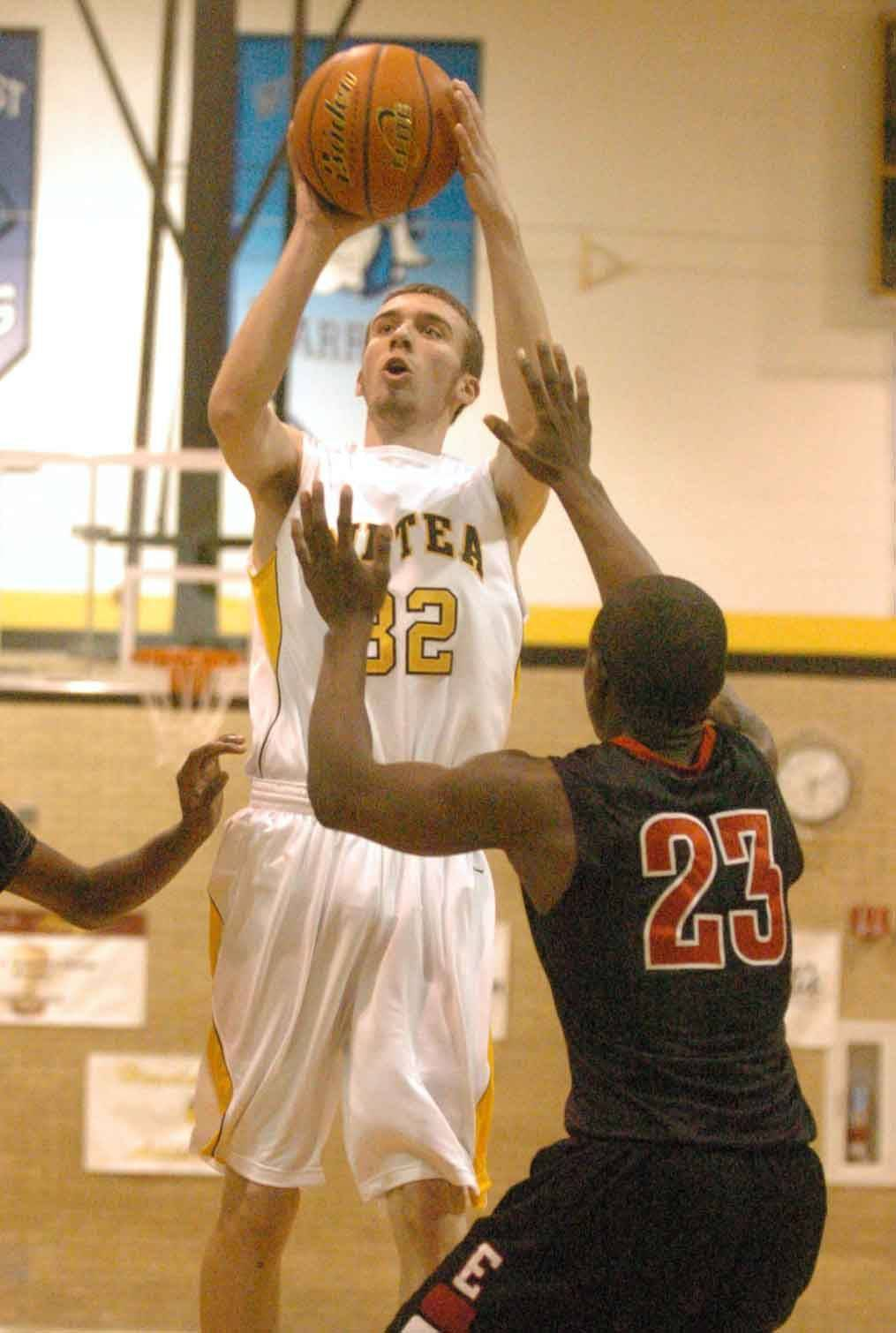 Kenny Obendorf of Metea Valley takes a shot over Isaac Bronaugh of Eisenhower at the Hinsdale South tournament Tuesday.