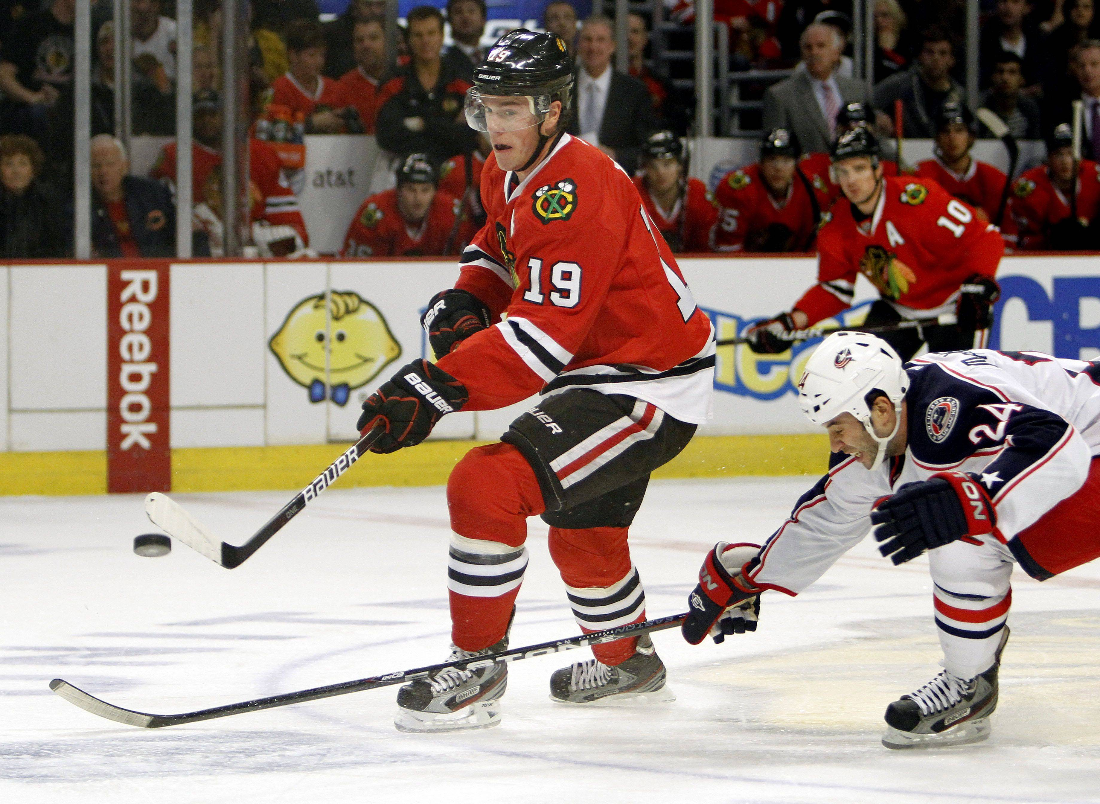 Chicago Blackhawks center Jonathan Toews drives past Columbus Blue Jackets center Derek MacKenzie during their game Monday night at the United Center in Chicago.