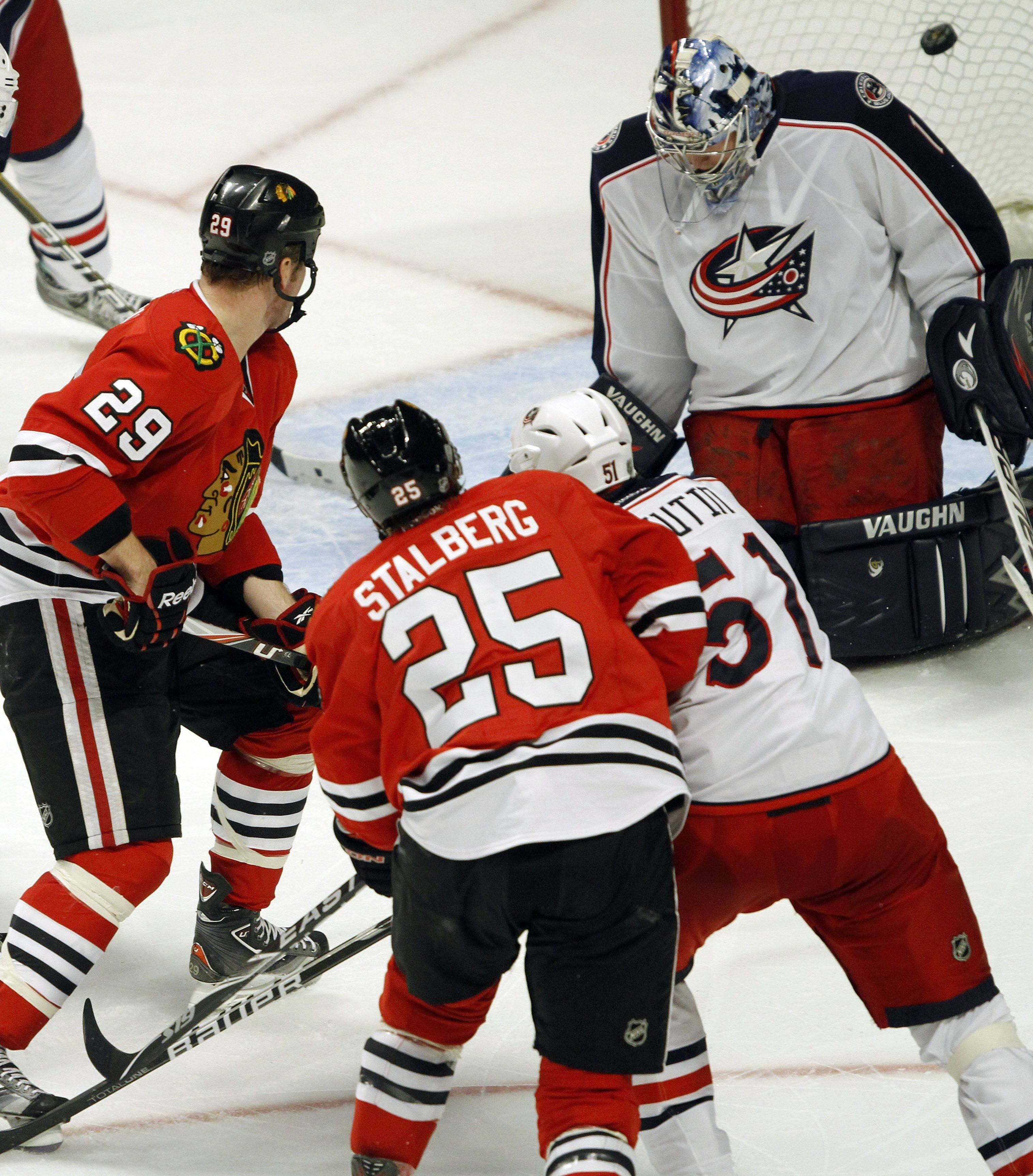 Chicago Blackhawks left wing Viktor Stalberg's shot makes it past Columbus Blue Jackets goalie Steve Mason for his second goal of the second period during their game Monday night at the United Center in Chicago.