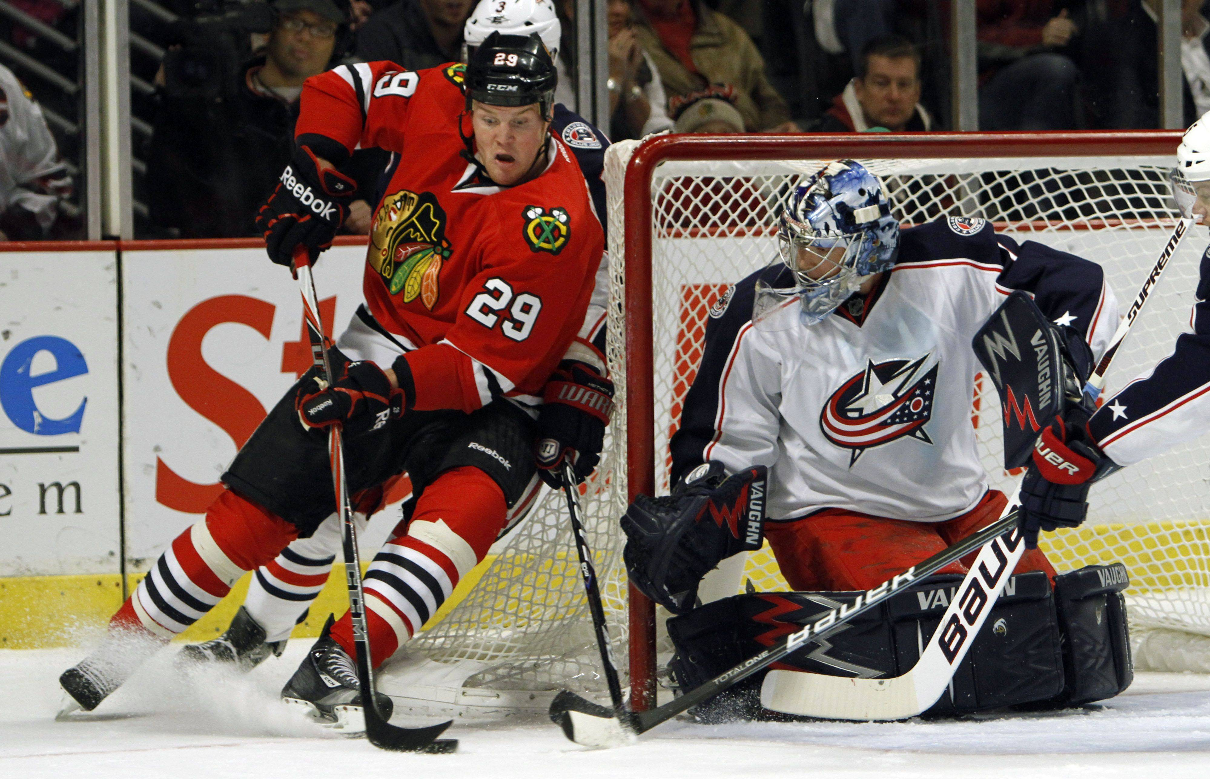 Chicago Blackhawks left wing Bryan Bickell tries a wrap around on Columbus Blue Jackets goalie Steve Mason during their game Monday night at the United Center in Chicago.