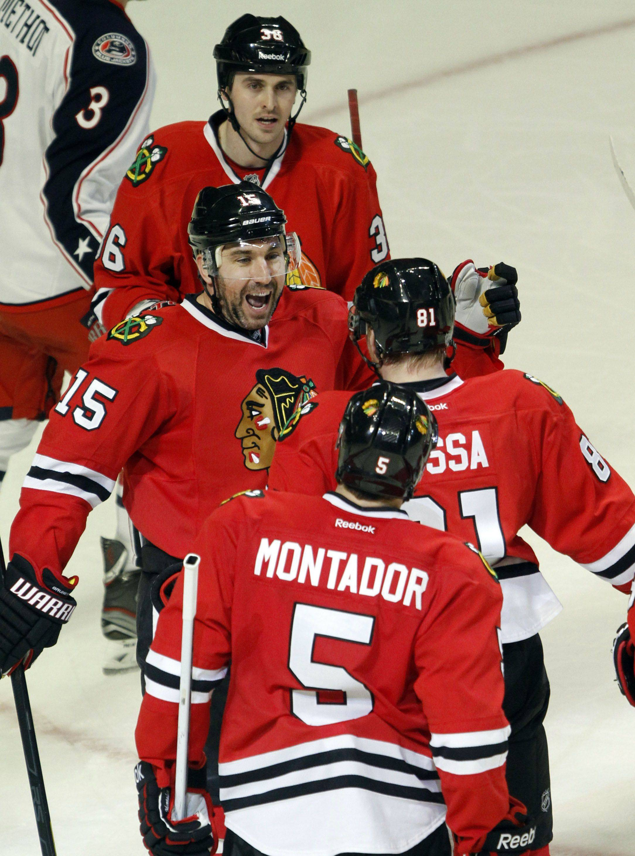 Chicago Blackhawks right wing Marian Hossa is congratulated by his teammates after scoring his goal second goal of the game during their game Monday night at the United Center in Chicago.
