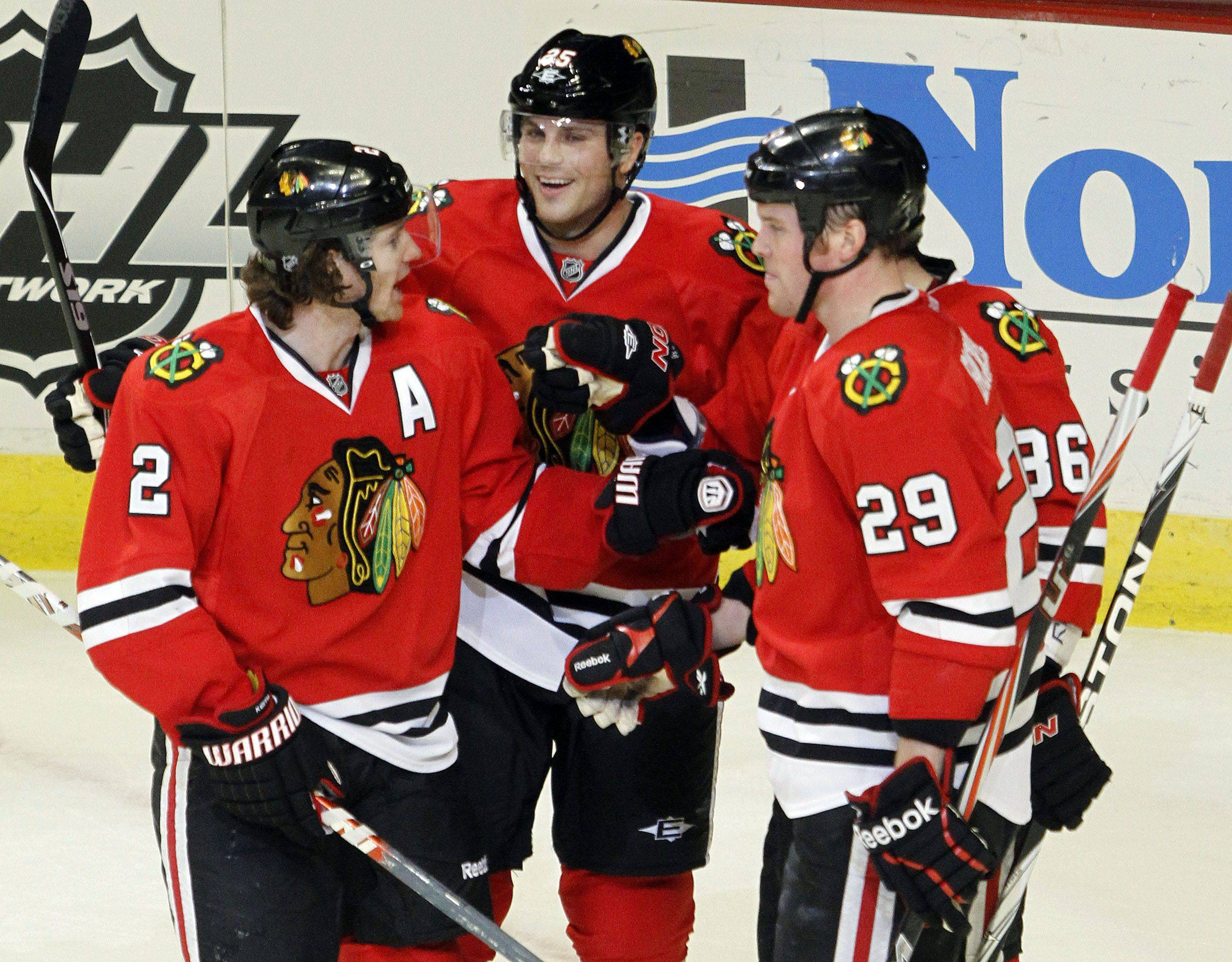 Blackhawks players celebrate with Chicago Blackhawks left wing Viktor Stalberg after his second goal of the second period during their game Monday night at the United Center in Chicago.