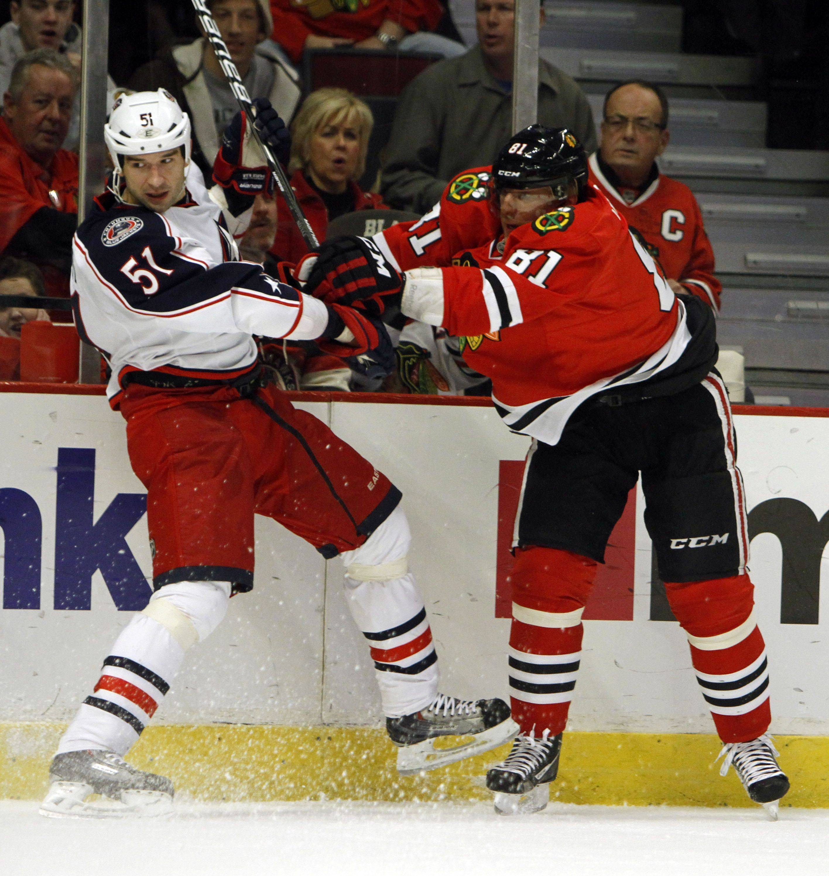 Chicago Blackhawks right wing Marian Hossa checks Columbus Blue Jackets defenseman Fedor Tyutin during their game Monday night at the United Center in Chicago.
