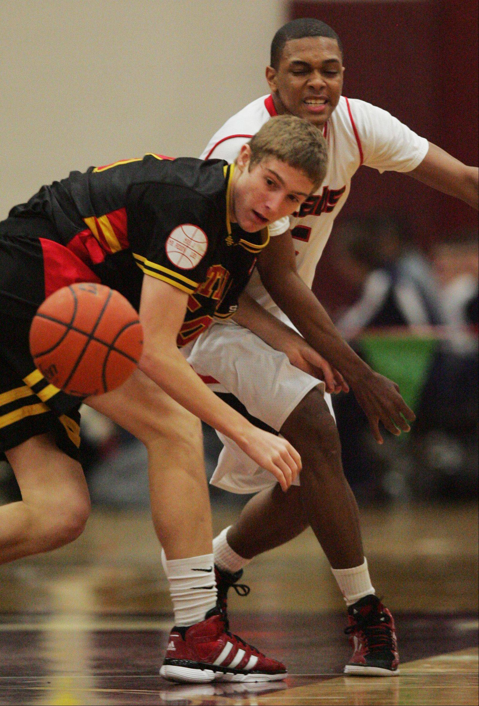 Batavia's Tucker Knox watches as the ball bounces away Monday at the Elgin boys basketball tournament.