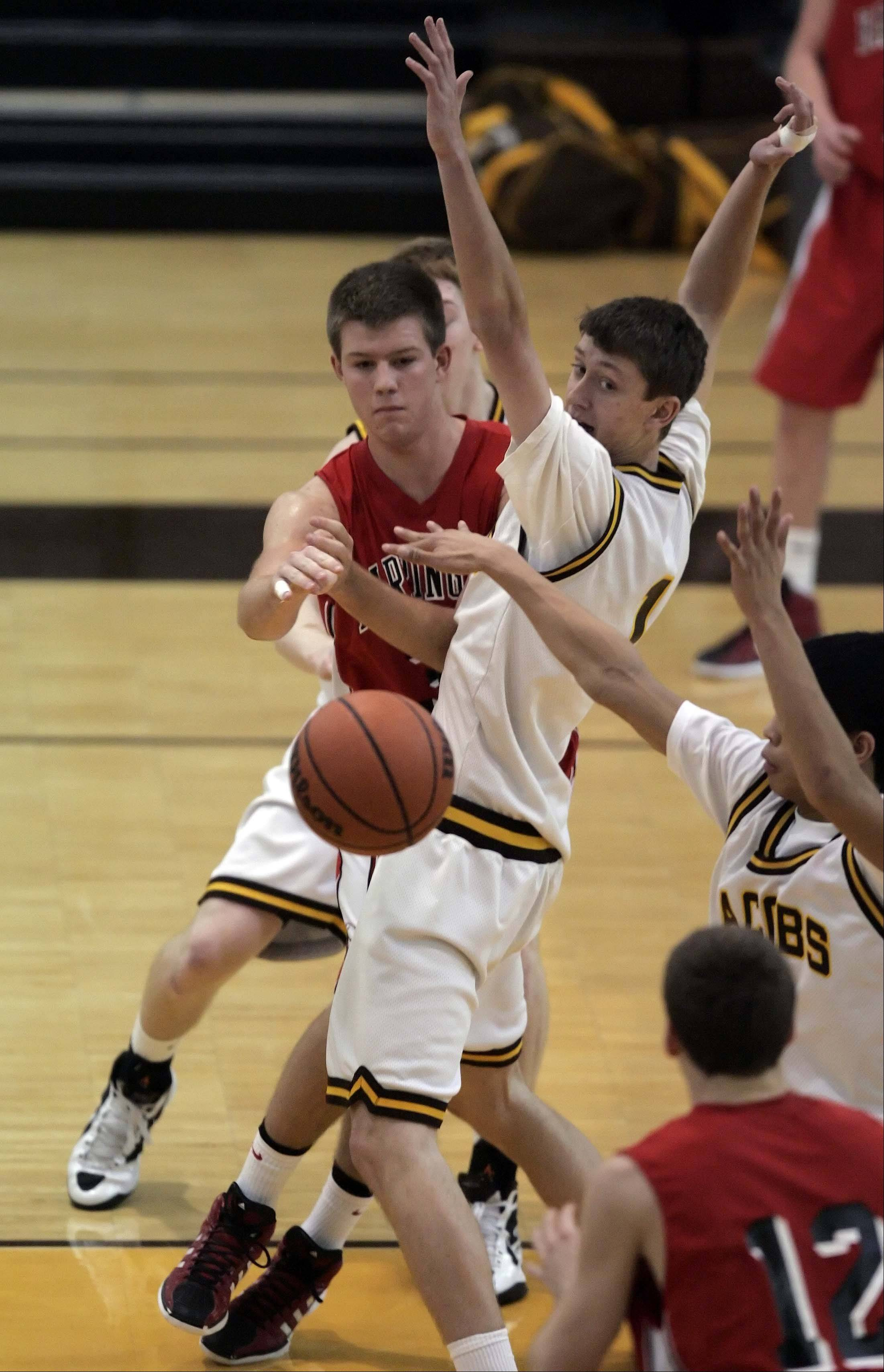 Barrington forward Mark Bennett, 33, looks for an opening past Jacobs Nick Lendinsky, 1, during the 2011 Jacobs Boys Holiday Basketball Classic in Algonquin Tuesday.