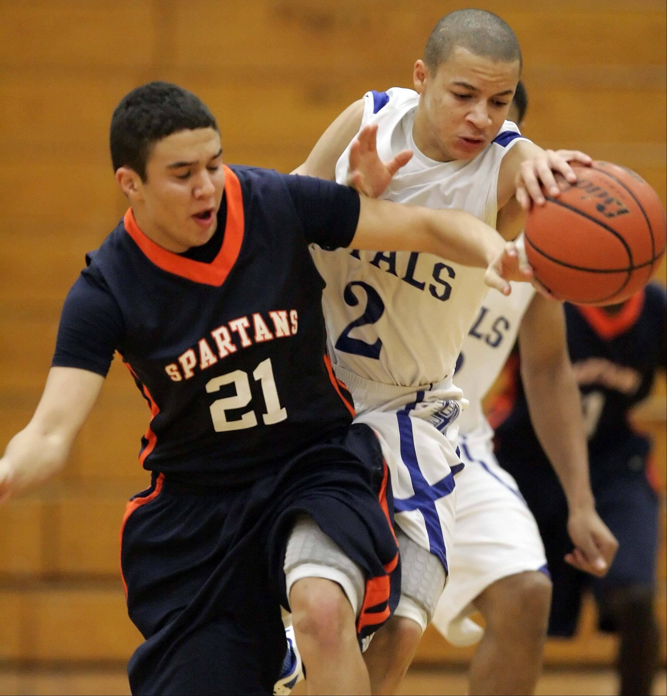 Romeoville guard Jake Bambule, 21, and Larkin guard Derrick Streety, 2, battle for the ball at the Elgin Boys basketball tournament Wednesday.