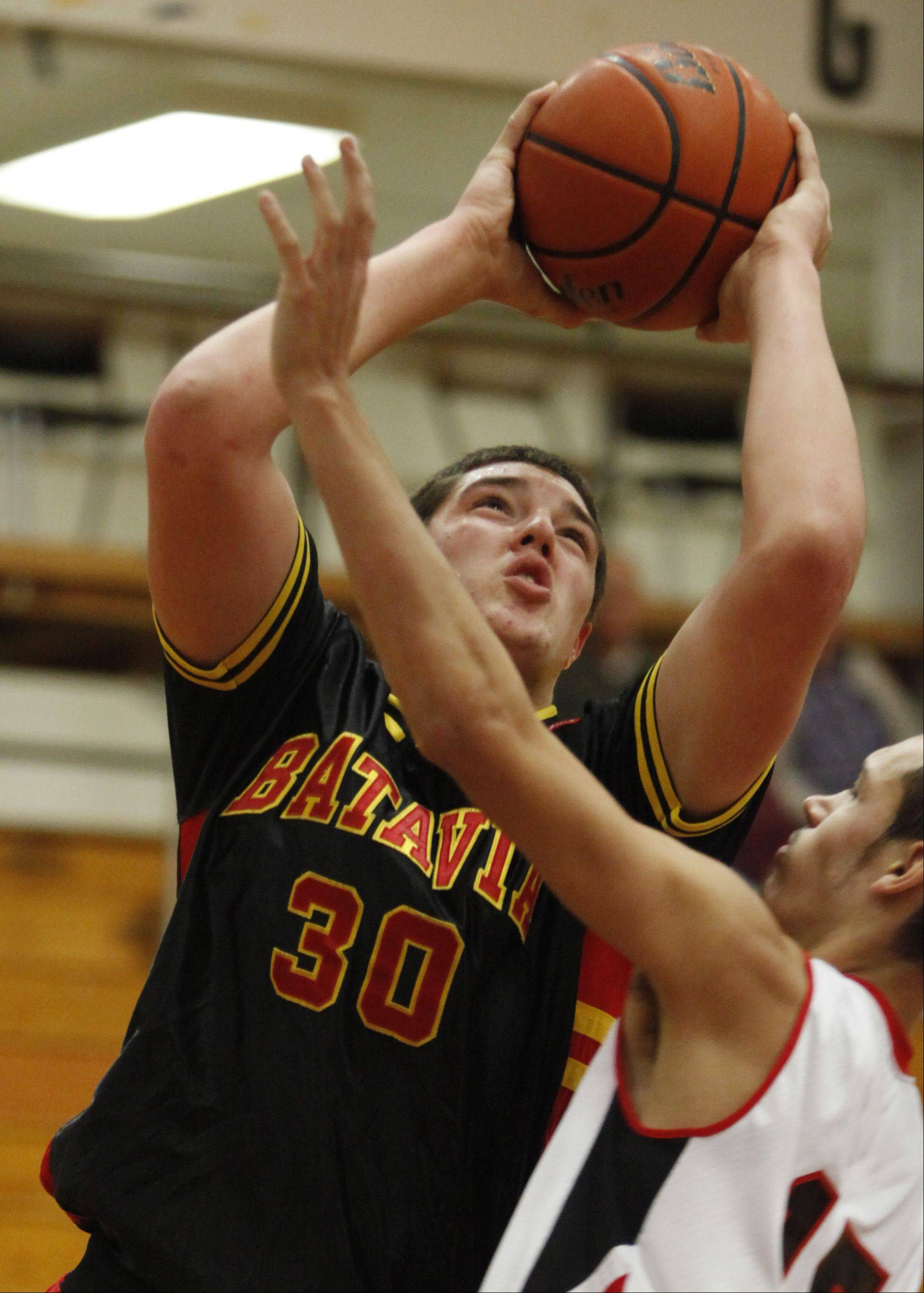 Batavia's Cole Gardner muscles his way to the hoop Monday against Rockford East in Elgin.