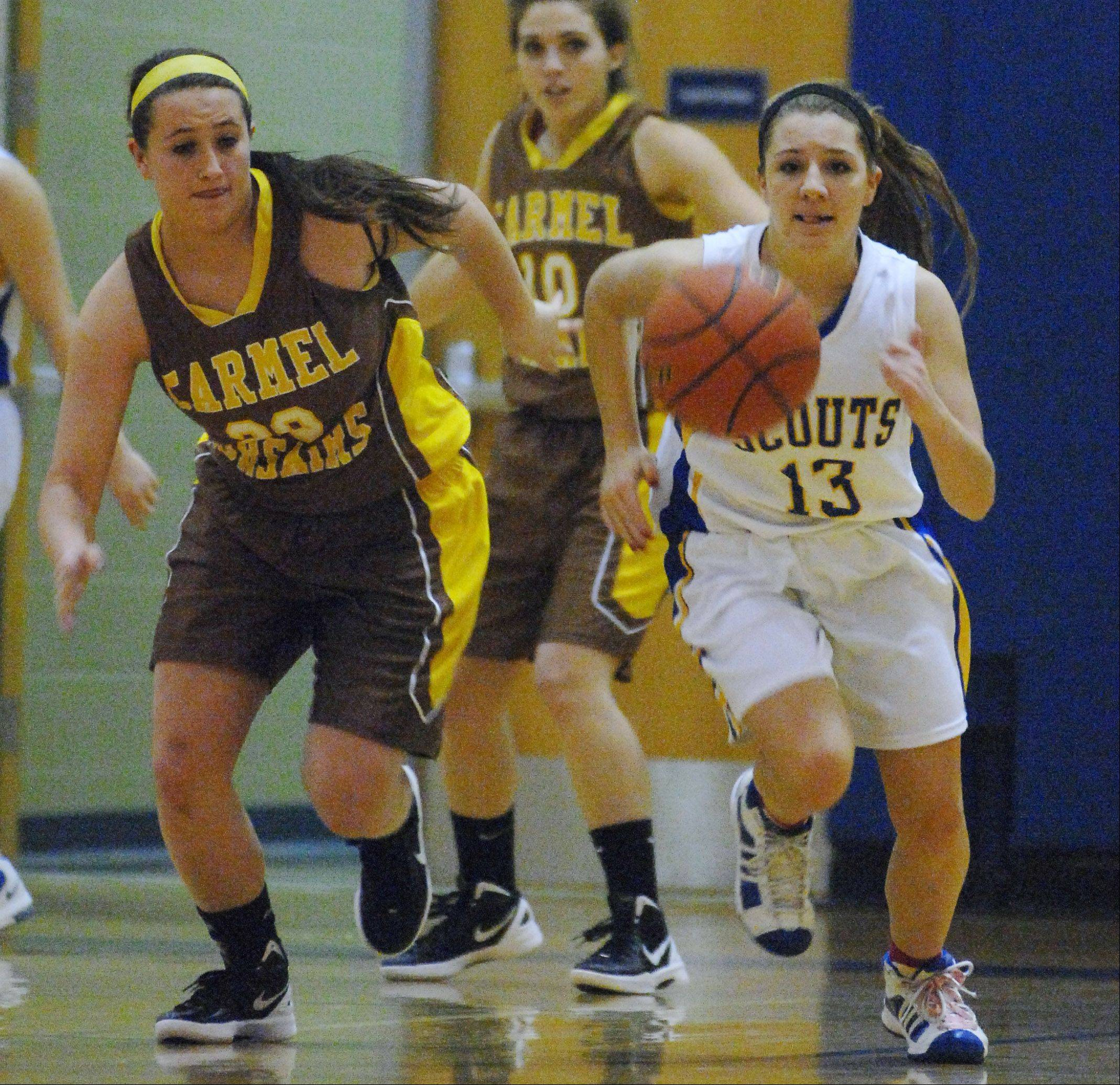 Carmel's Jackie Meier, left, chases down a loose ball with Lake Forest's Gabby Perino during Monday's Blue Devil Classic basketball game in Gurnee.