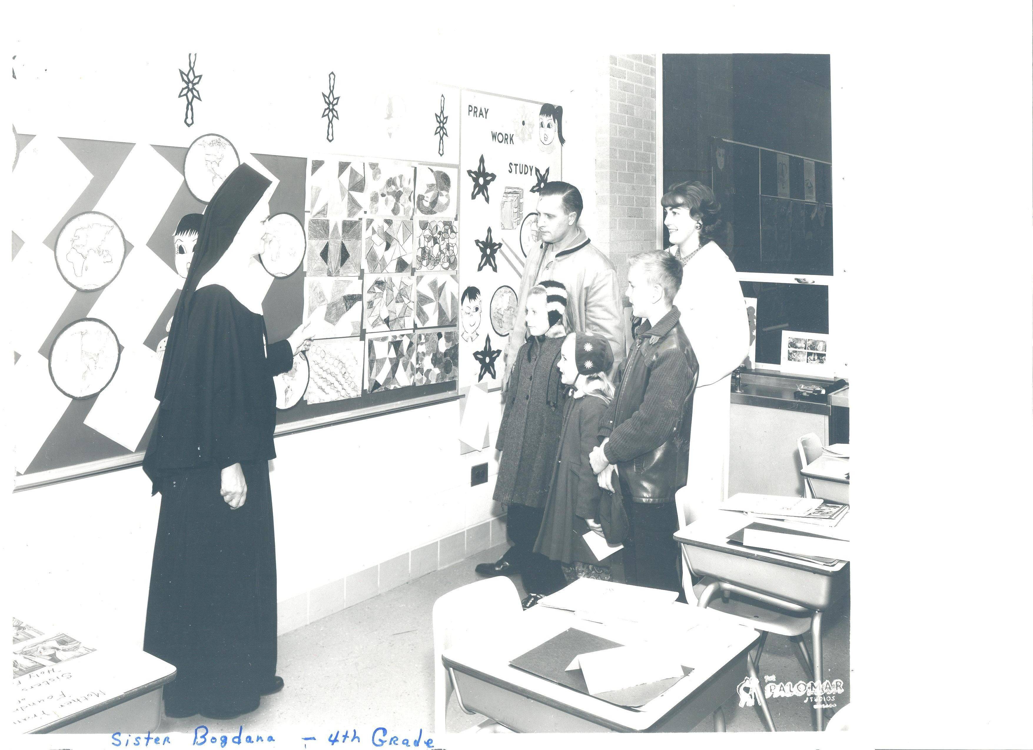 Sr. Bogdana greets a family in her fourth-grade classroom in 1963 at St. Emily School.