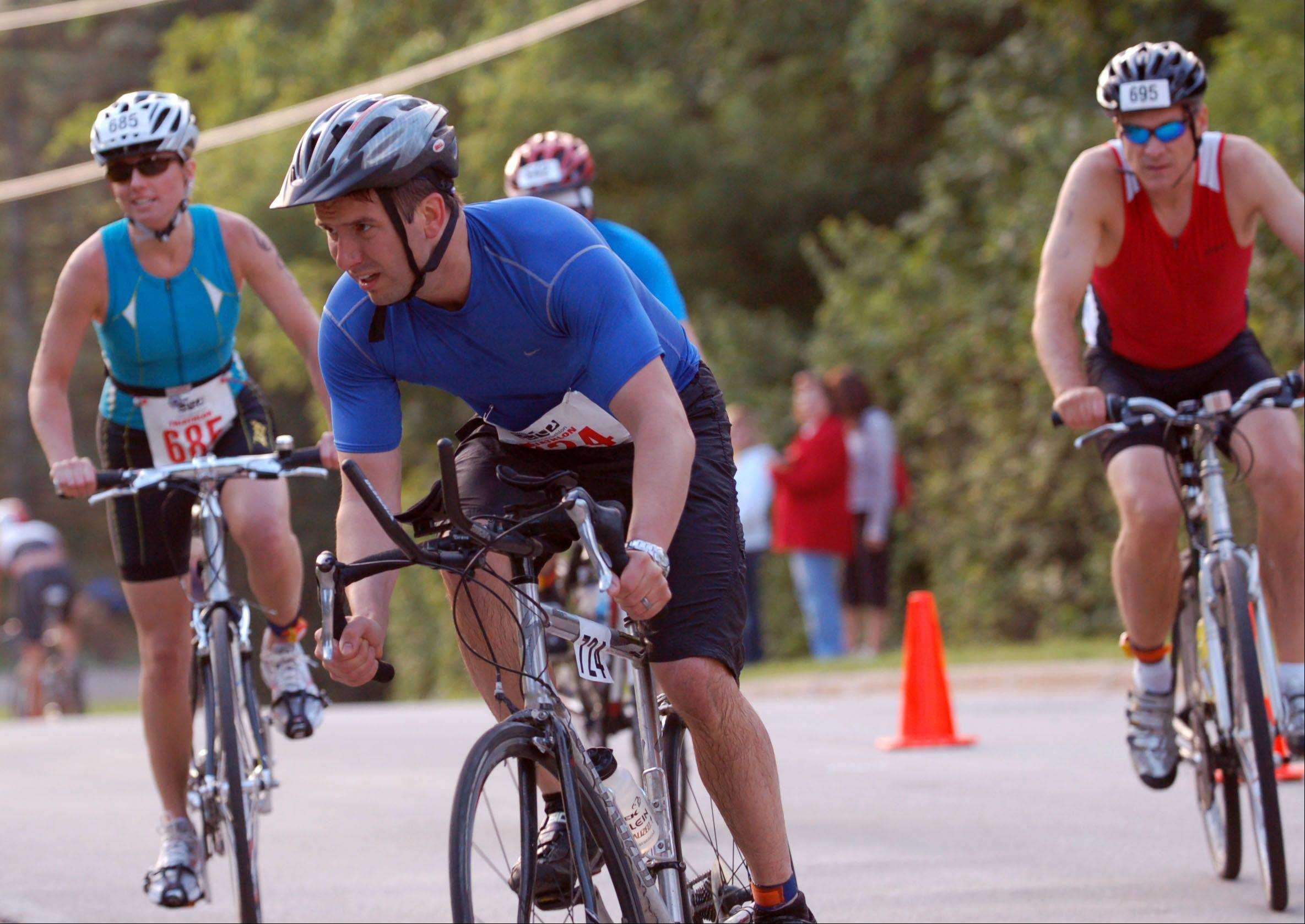 Bicyclists take a sharp curve in Batavia during last year's Batavia Triathlon. The race returns June 10, 2012 with a new title sponsor and new director.