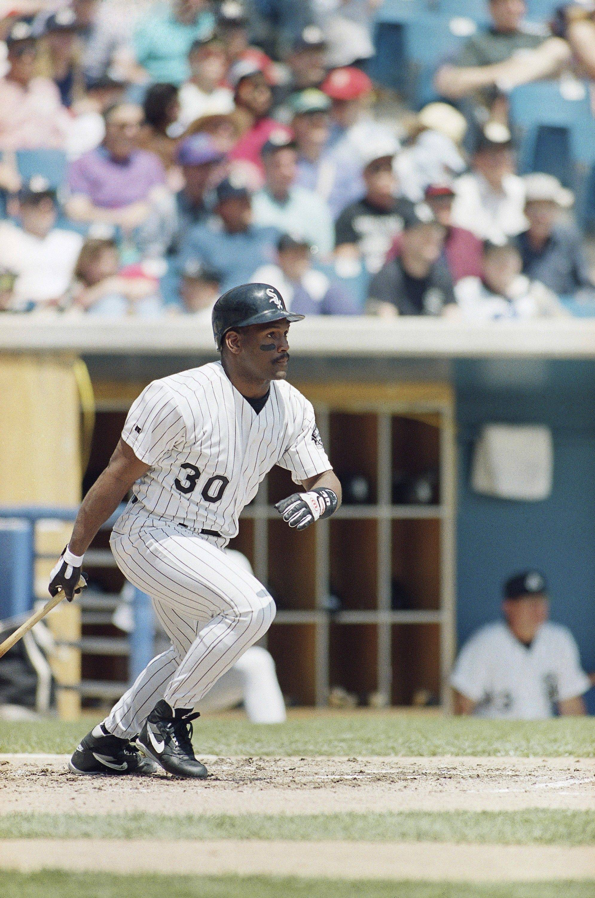 Chicago White Sox Tim Raines heads to first with a lead off single against the Oakland Athletics during the first inning in Chicago , May 22, 1993. Raines was reinstated after being on the disabled list since rupturing a ligament in his right thumb on April 9.