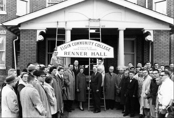 The opening of Renner Hall, Elgin Community College's first main building, includes college President Gilbert Renner standing in front of the ladder. To the left of the ladder are Erika Varrak, Orrin Thompson and Ashley Arnold. The boy in the bow tie is Richard Renner and behind him is his mother, Marsha Renner. But who are the others?
