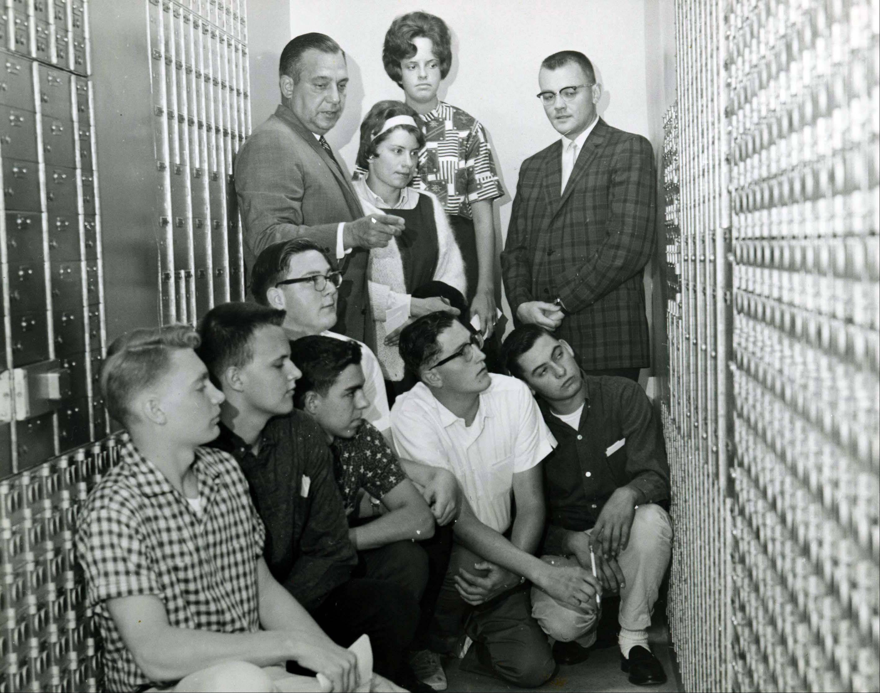 These students seem quite interested in learning about safety deposit boxes, but who are they?