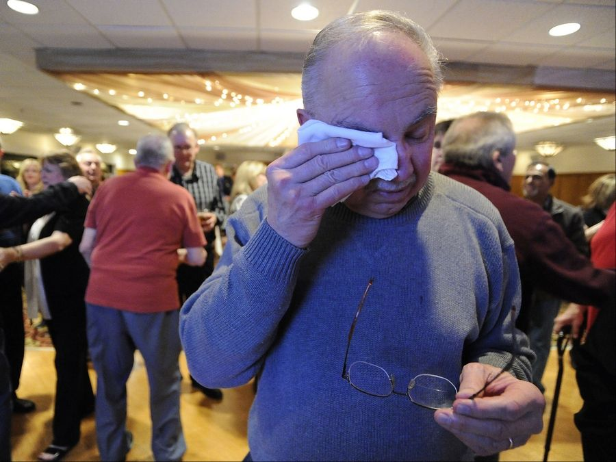 Schaumburg's Mayor Al Larson cries tears of joy after he learns he was re-elected.