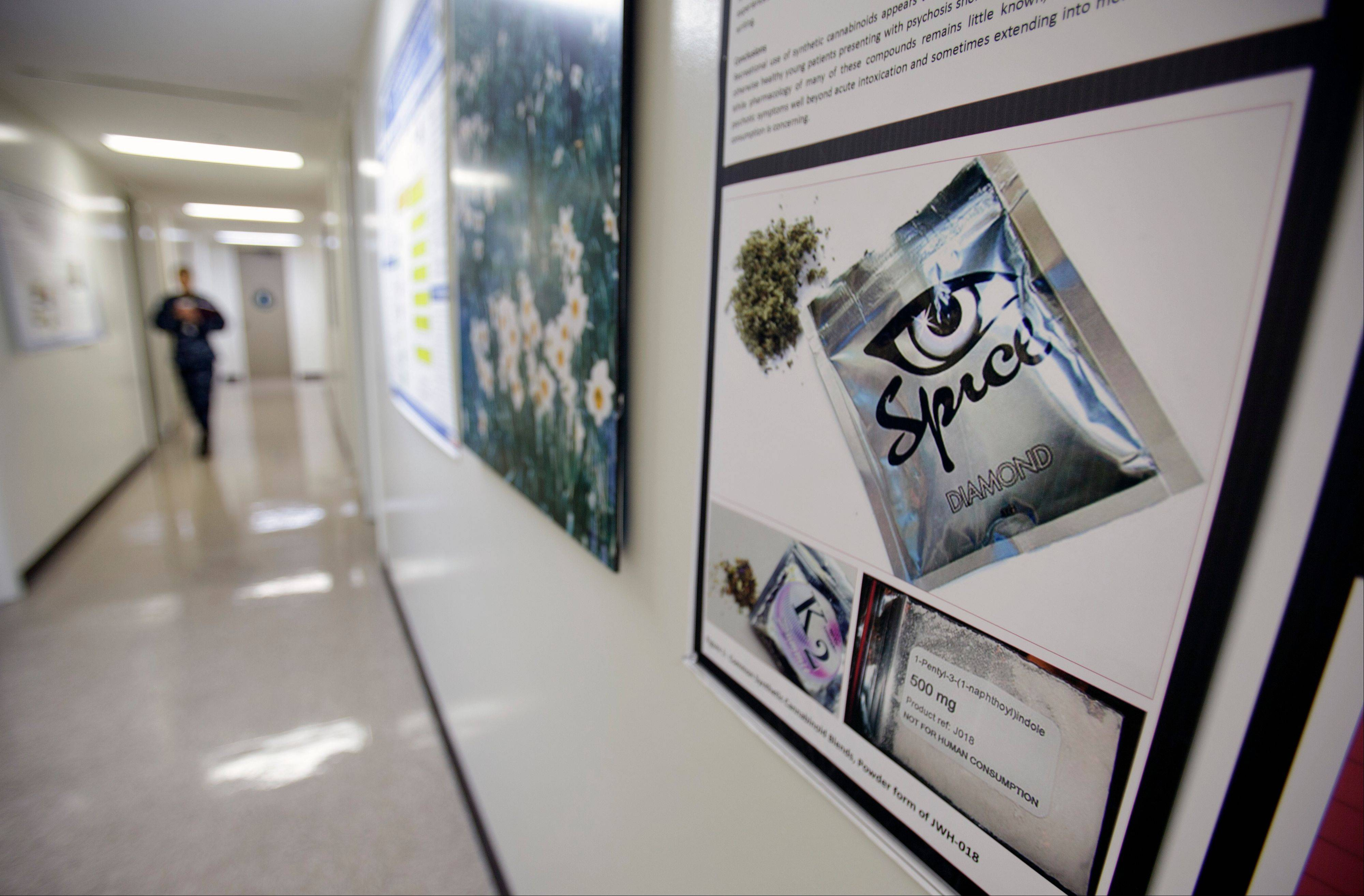 A poster warning of the effects of the drug known as 'spice' hangs on a wall at the Naval Hospital, in San Diego. The U.S. Navy has kicked out a record number of sailors and Marines this year for smoking synthetic marijuana and is seeing a dramatic jump in emergency room visits of its users, including some who babbled or hallucinated for eight days.