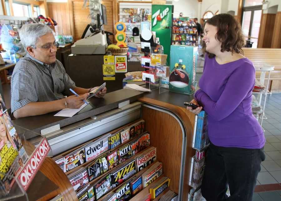 Dilip Patel, owner of Gateway Newsstand in the Arlington Heights Metra station, said he trusted AnnMarie Walsh to watch his shop when he had to leave the station.