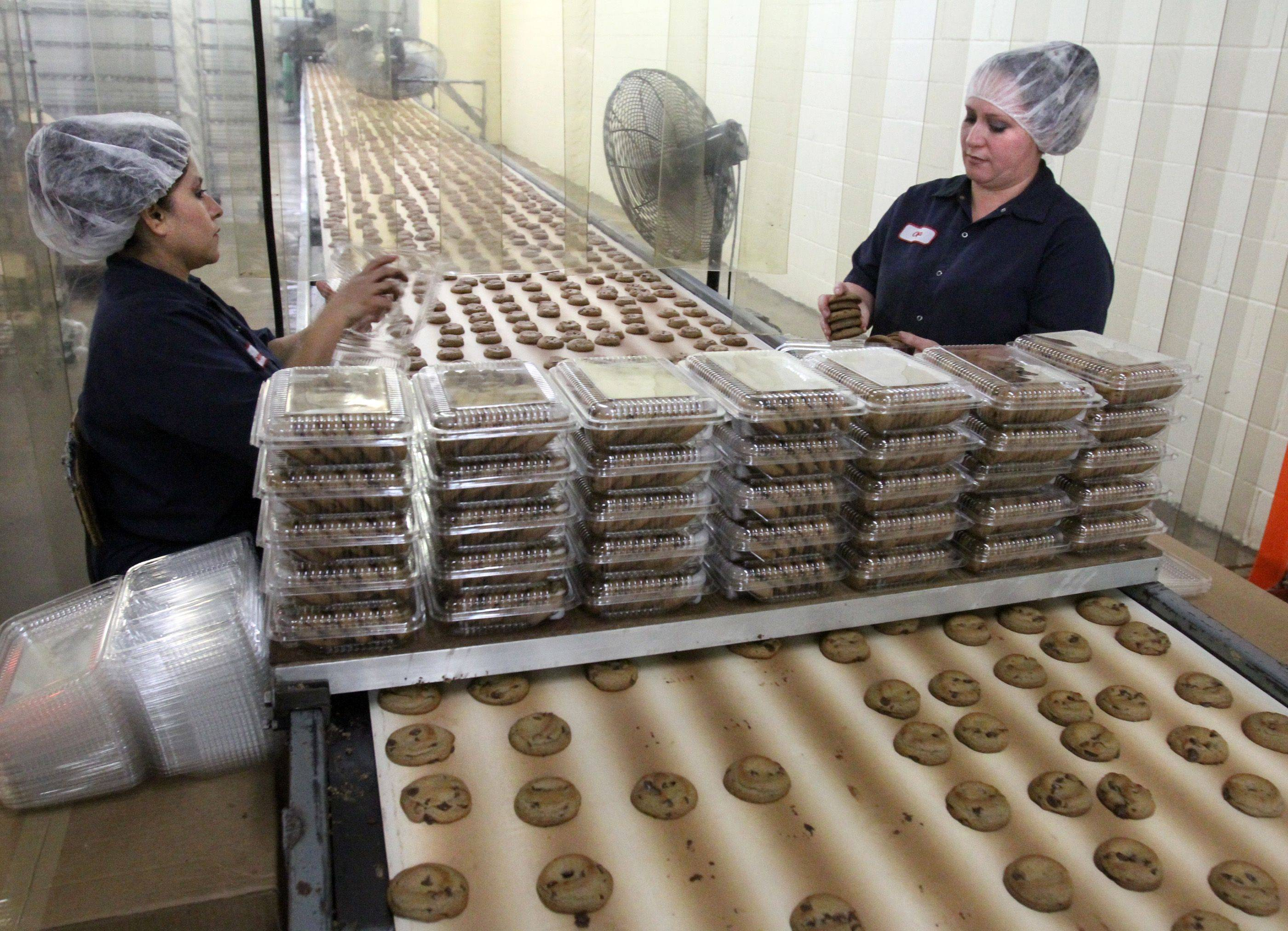 Irma Martinez and Olga Ochoa package chocolate chip cookies at Matt's Cookies in Wheeling.