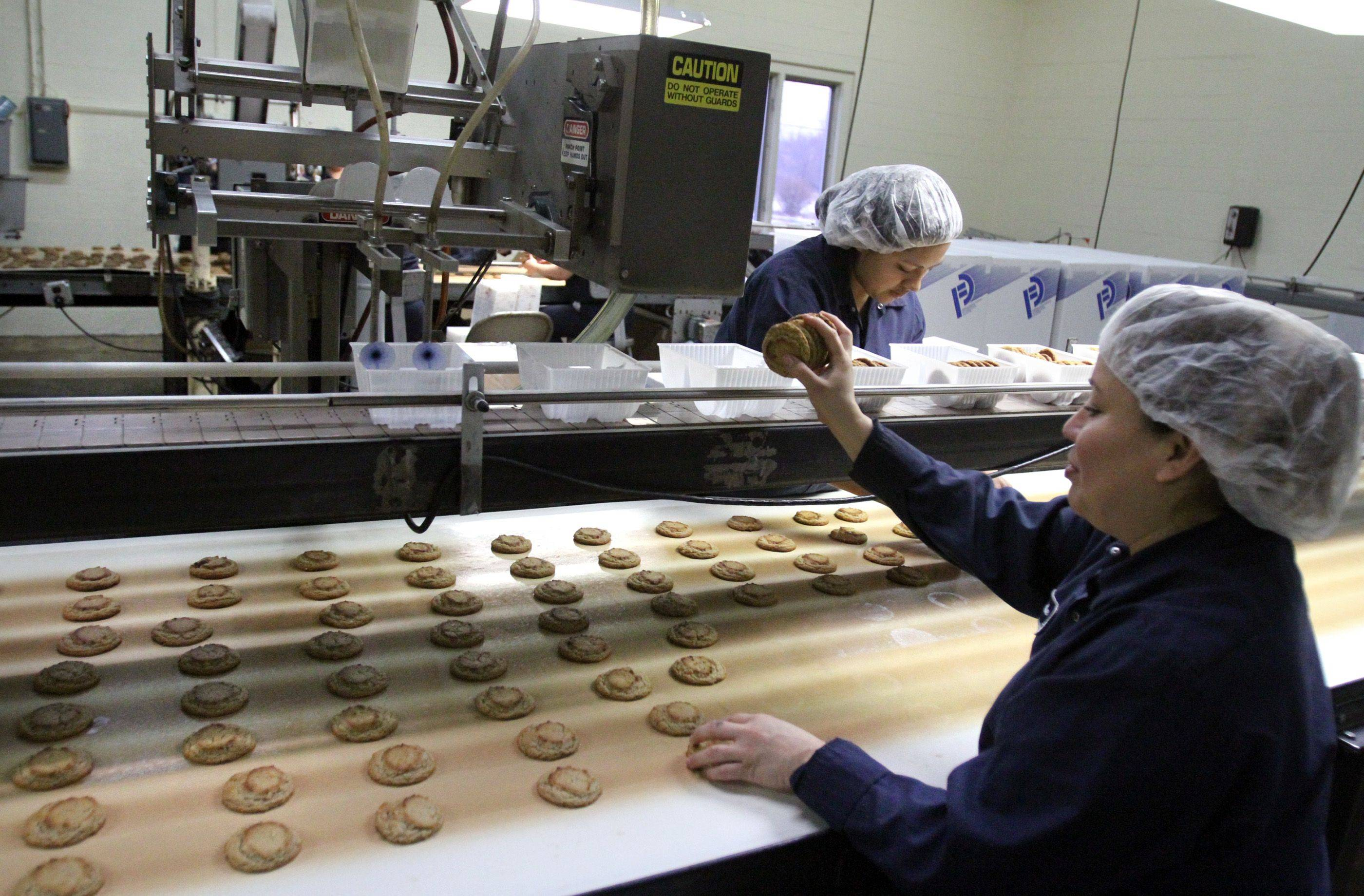 Celedonia Vel�squez packages peanut butter cookies by hand at Matt's Cookies in Wheeling.