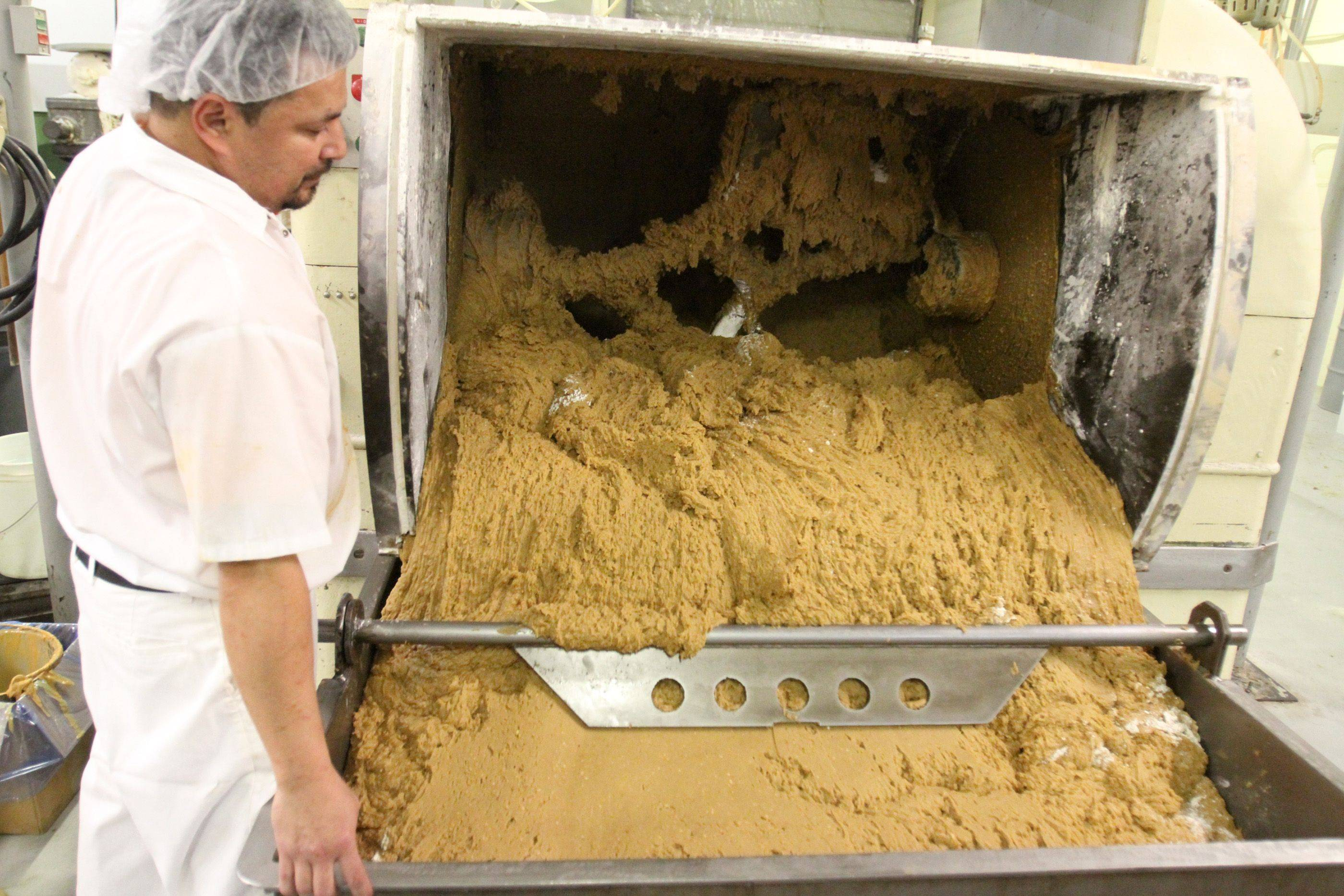 Gerardo Ramirez mixes cookie dough in one of two giant mixers.