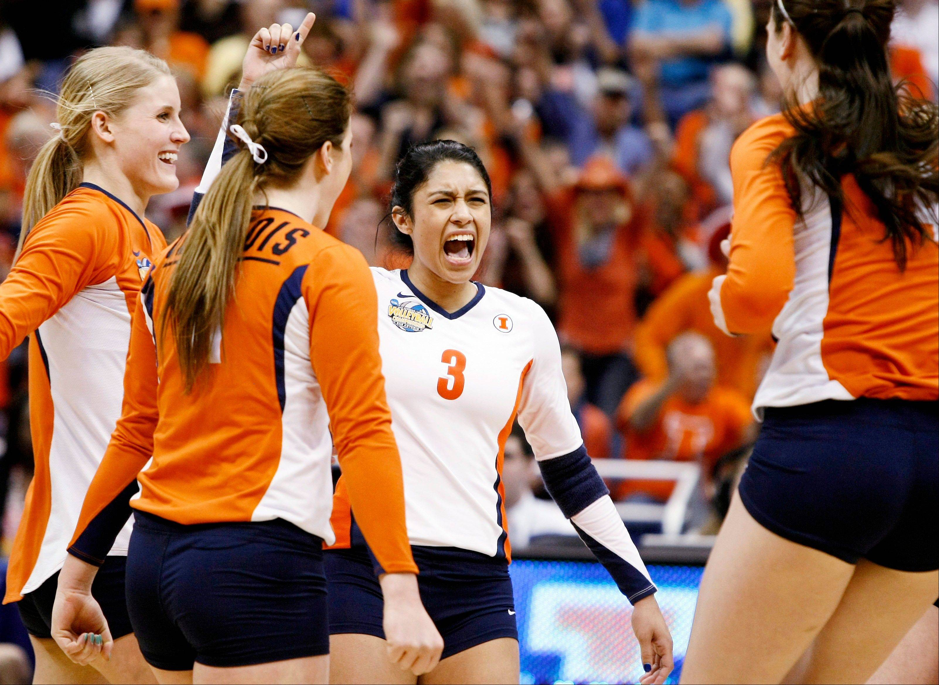 Illinois' Jennifer Beltran, center, celebrates a point with teammates Colleen Ward, left, Annie Luhrsen and Liz McMahon, right, during the NCAA championship match against UCLA. The Illini fell 3-1 but finished as national runners-up for the first time.