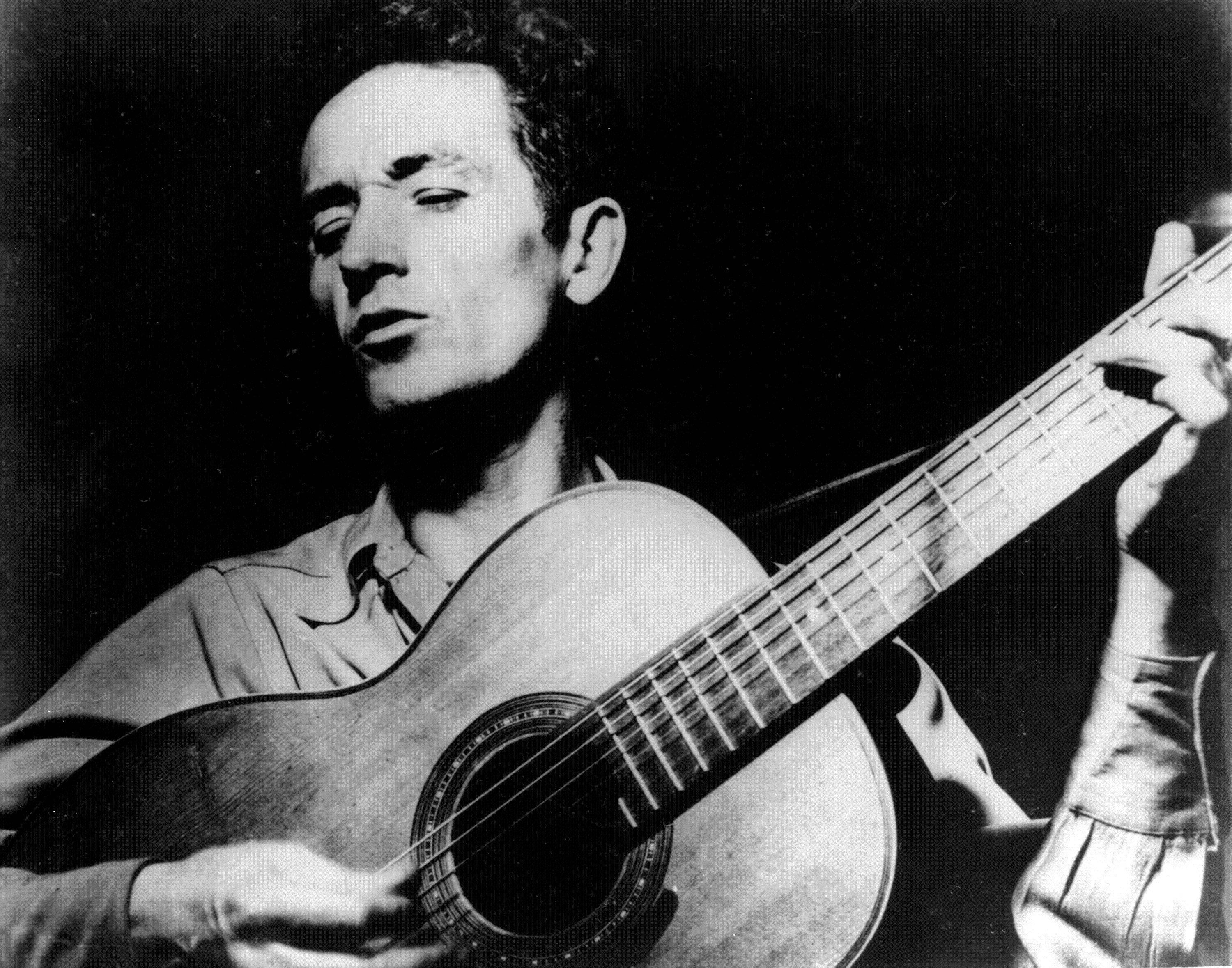 Woody Guthrie's writings, recordings and artwork will land in his native state after an Oklahoma foundation bought the collection, with plans for a display that concentrates on his artistry rather than the populist politics that divided local opinion over the years.