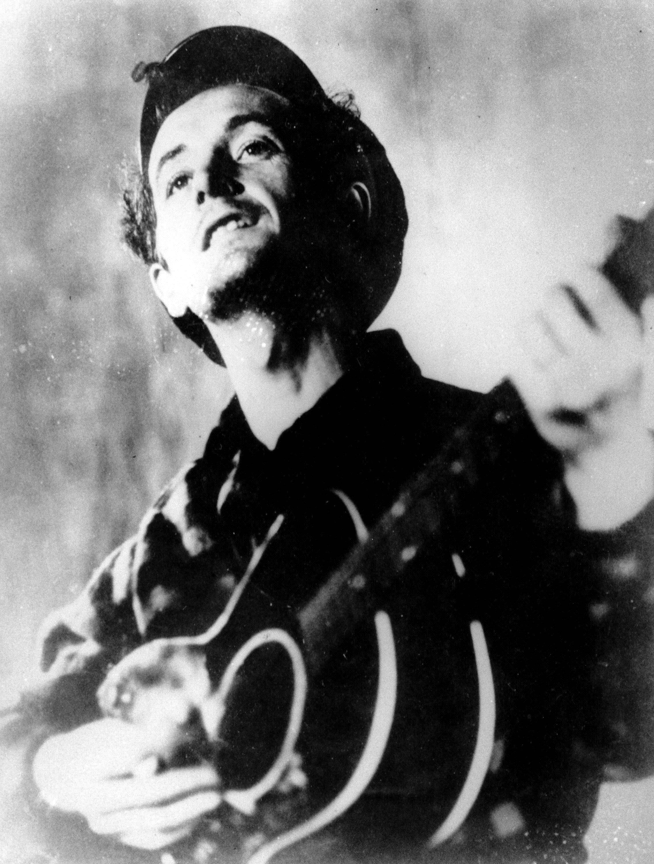 "Folk singer Woody Guthrie, known for the anthem ""This Land is Your Land"" and his songs about the poor and downtrodden, is remembered mostly as a musician, composer and singer but was also a literary figure and an artist, said Bob Blackburn, executive director of the Oklahoma Historical Society."