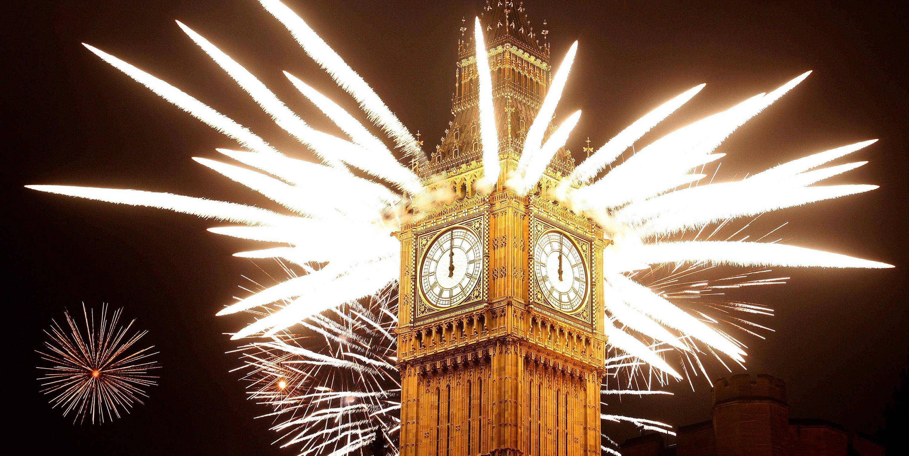 Fireworks explode over the Houses of Parliament, including St Stephen's Tower which holds the bell known as Big Ben as London celebrates the arrival of New Year's Day Sunday, Jan. 1, 2012.