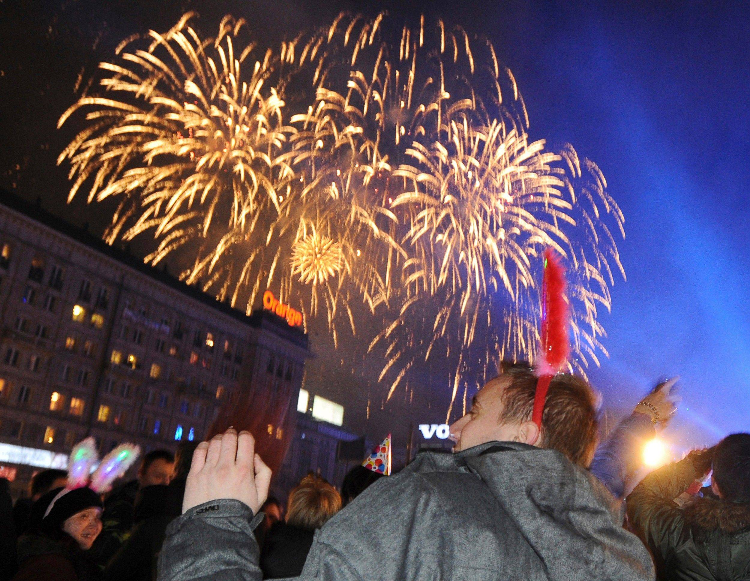 People welcome the New Year at the Constitution Square in Warsaw, Poland, Sunday, Jan. 1, 2012.