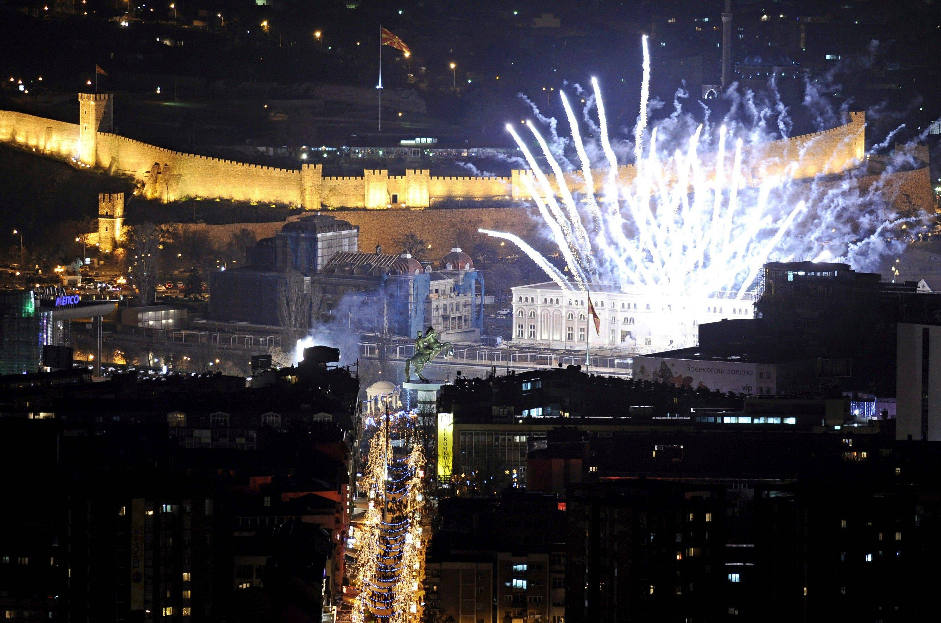 Fireworks light the sky shortly after midnight during New Year's celebrations in downtown Macedonia's capital Skopje, Sunday, Jan. 1, 2012.